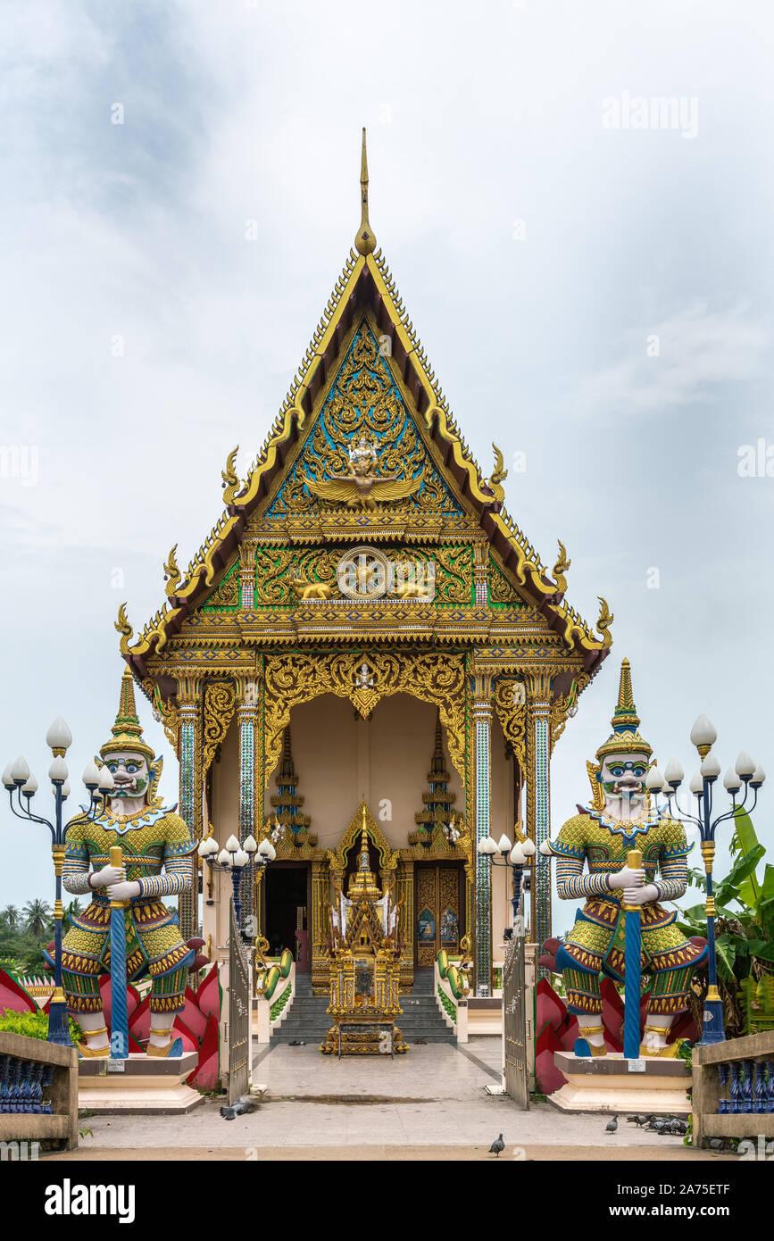 Ko Samui Island, Thailand - March 18, 2019: Wat Laem Suwannaram Chinese Buddhist Temple. Entrance to Wat Plai Laem shrine with two dwarapalaka statues Stock Photo