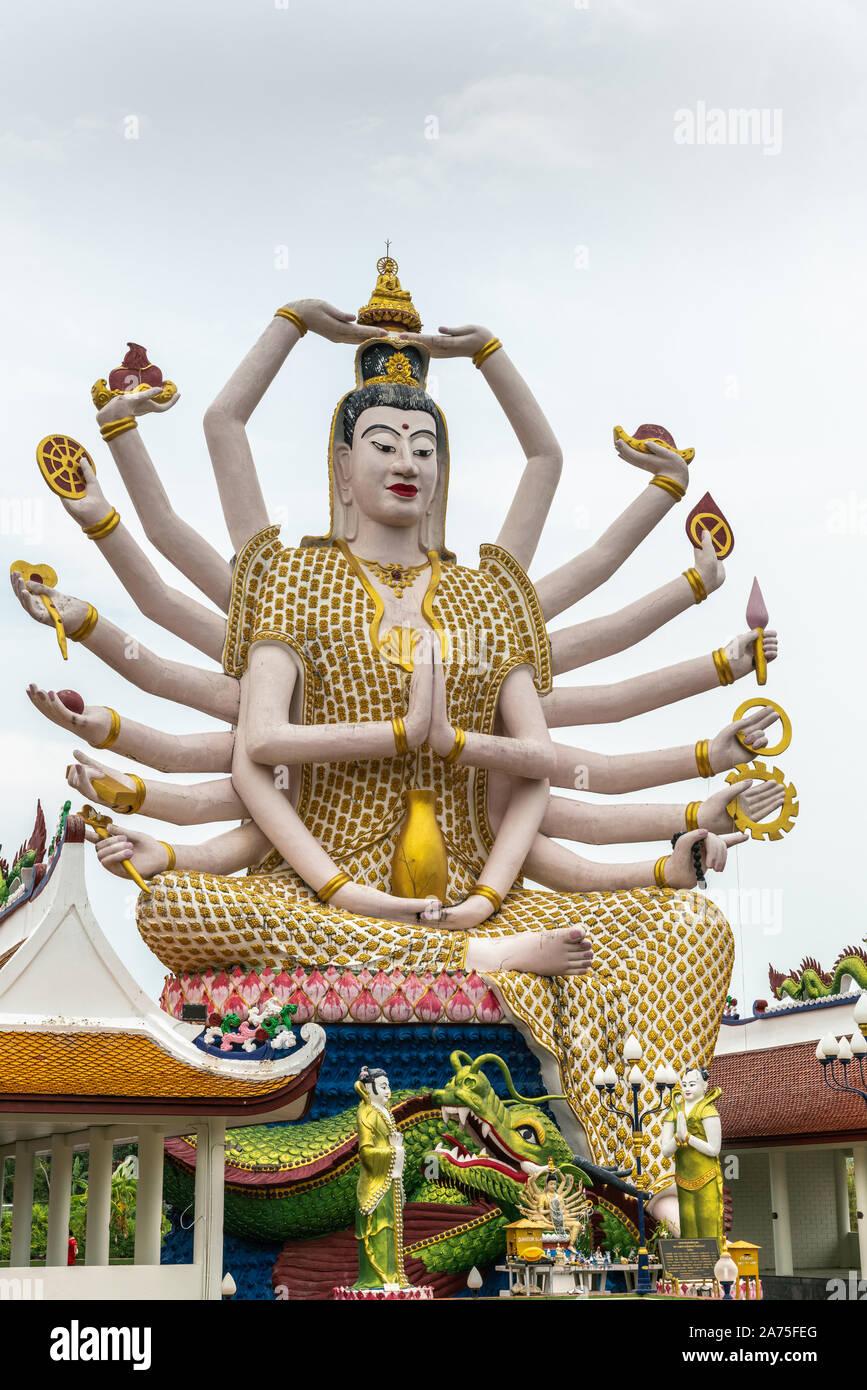 Ko Samui Island, Thailand - March 18, 2019: Wat Laem Suwannaram Chinese Buddhist Temple. Closeup of Giant Guan Yin goddess statue with 18 arms towerin Stock Photo