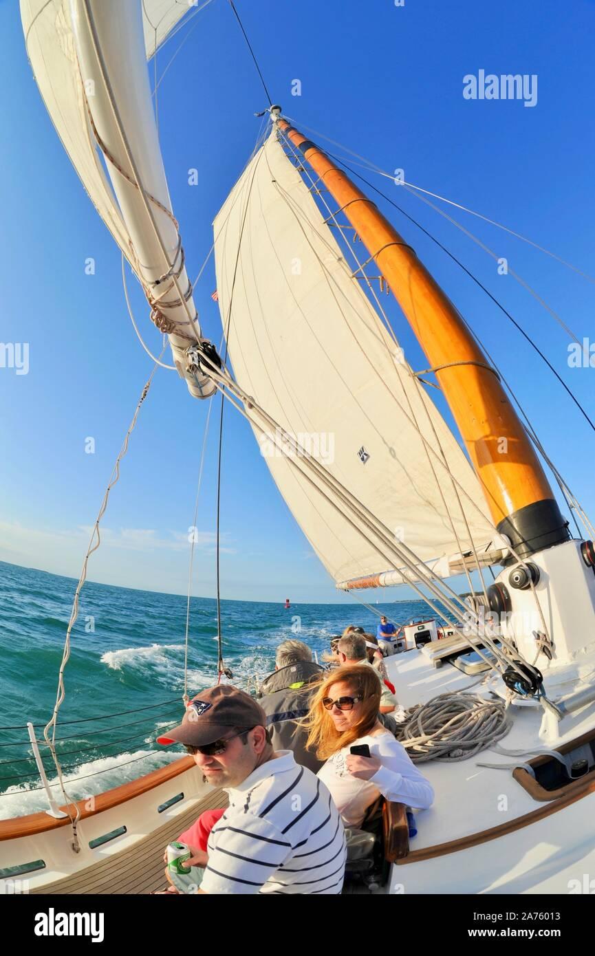 Passengers enjoying cruise on Schooner America 2.0 plying turquoise waters during sunset sail off Key West, Florida Keys, Florida, USA Stock Photo