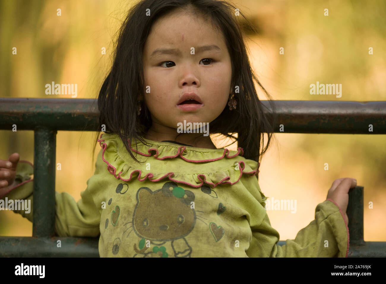 Sapa, Lao Cai, Vietnam - March 21, 2011: Cute little girl of Hmong ethnicity at traditional village around Sapa Stock Photo