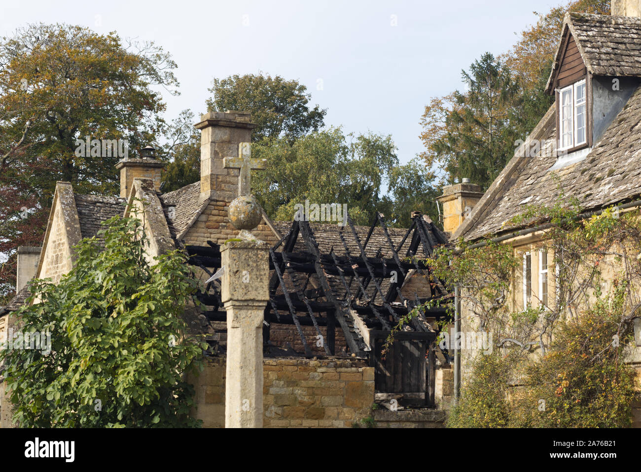 Burnt out stone cottage roof in the Cotswolds Stock Photo