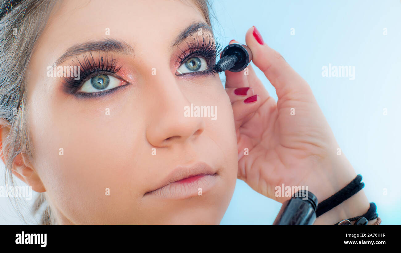 Makeup Professional Artist Applying Black Mascara On Lashes Of Model Eye Woman Beauty Model Close Up Stock Photo Alamy