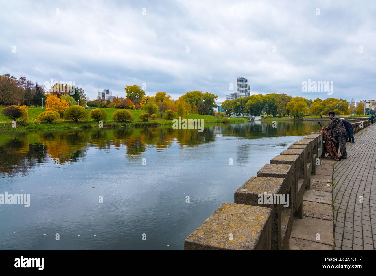 Minsk, Belarus - October, 13, 2019: Svisloch river and autumn cityscape of district Nyamiha in downtown Minsk, Belarus Stock Photo