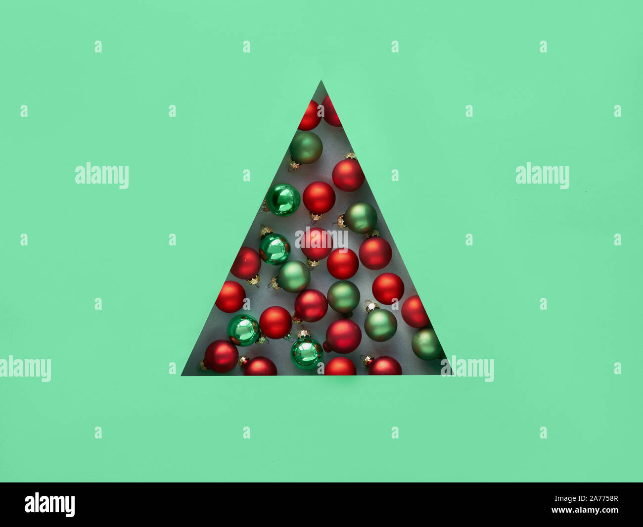 Geometric Creative Christmas Flat Lay In Neo Mint And Red Colors Xmas Baubles In Triangular Paper Hole In A Shape Of Christmas Tree Stock Photo Alamy
