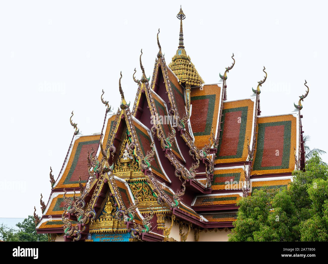 Ko Samui Island, Thailand - March 18, 2019: Wat Laem Suwannaram Chinese Buddhist Temple. Elaborately decorated multi-leveled roof structure with gold, Stock Photo