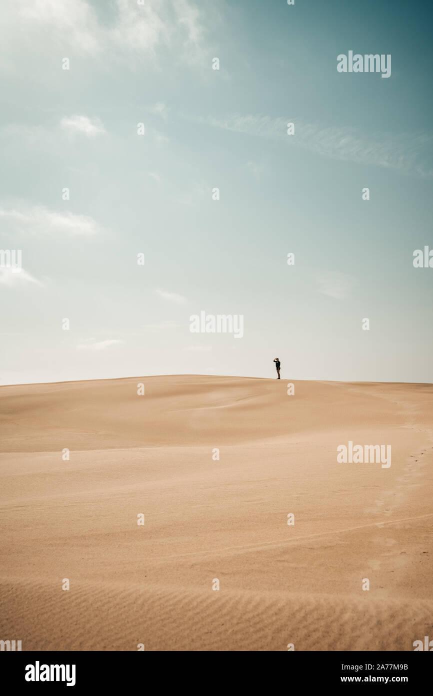 Person walks around on a Sand Dune Stock Photo