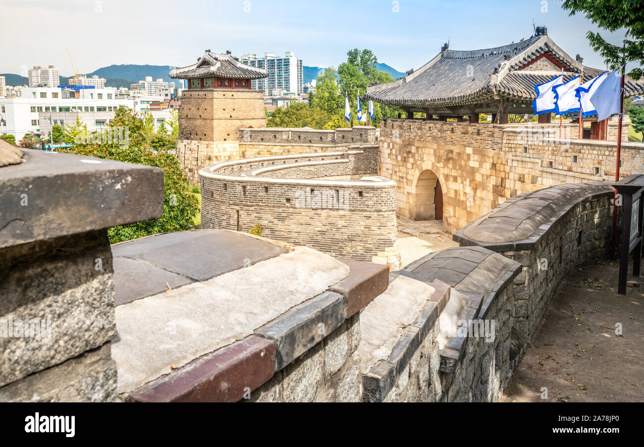 Scenic view of Suwon Hwaseong fortress with the western gate or Hwaseomun in Suwon South Korea Stock Photo