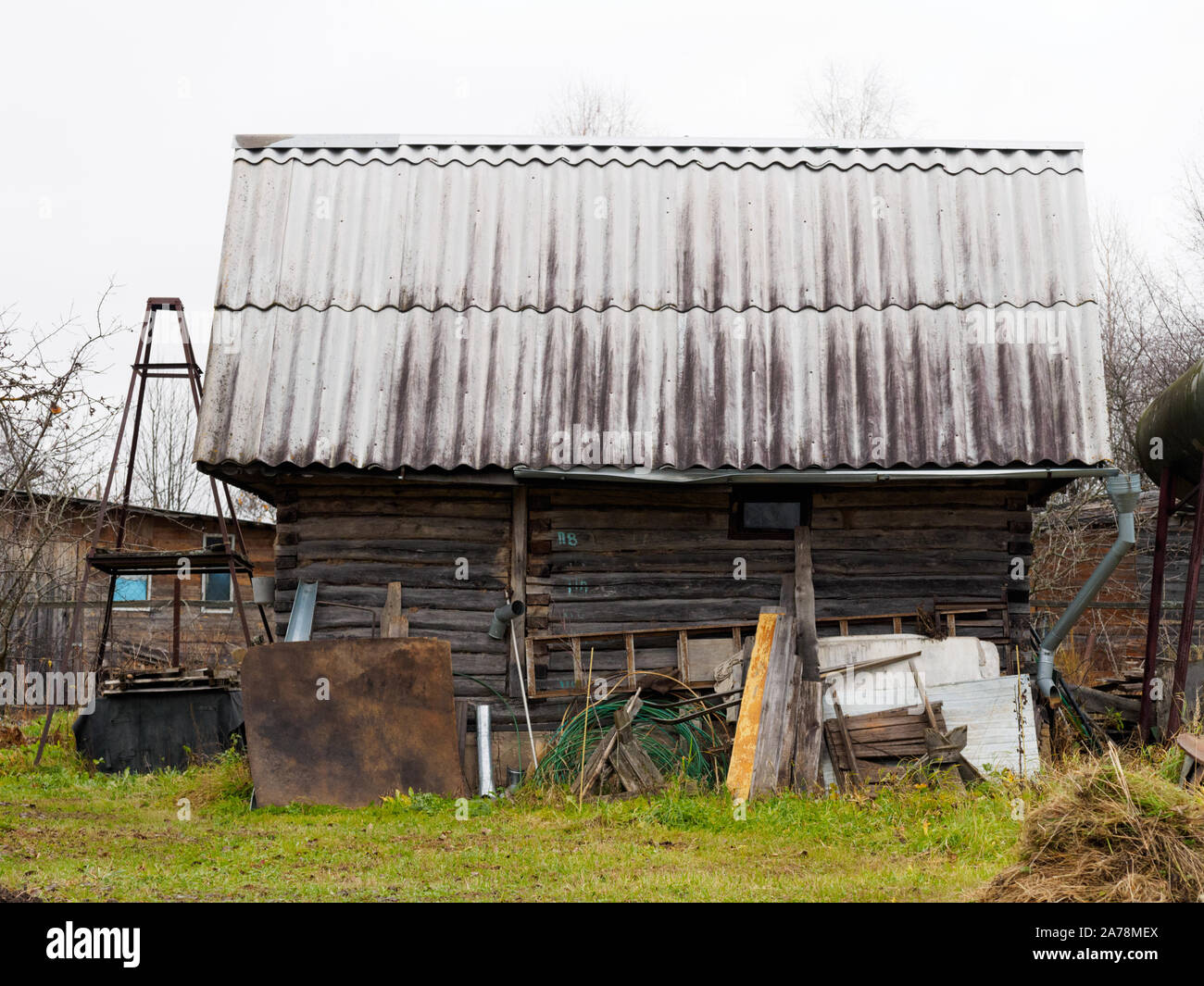 Old shed in the village of wooden beams and slate roof Stock Photo