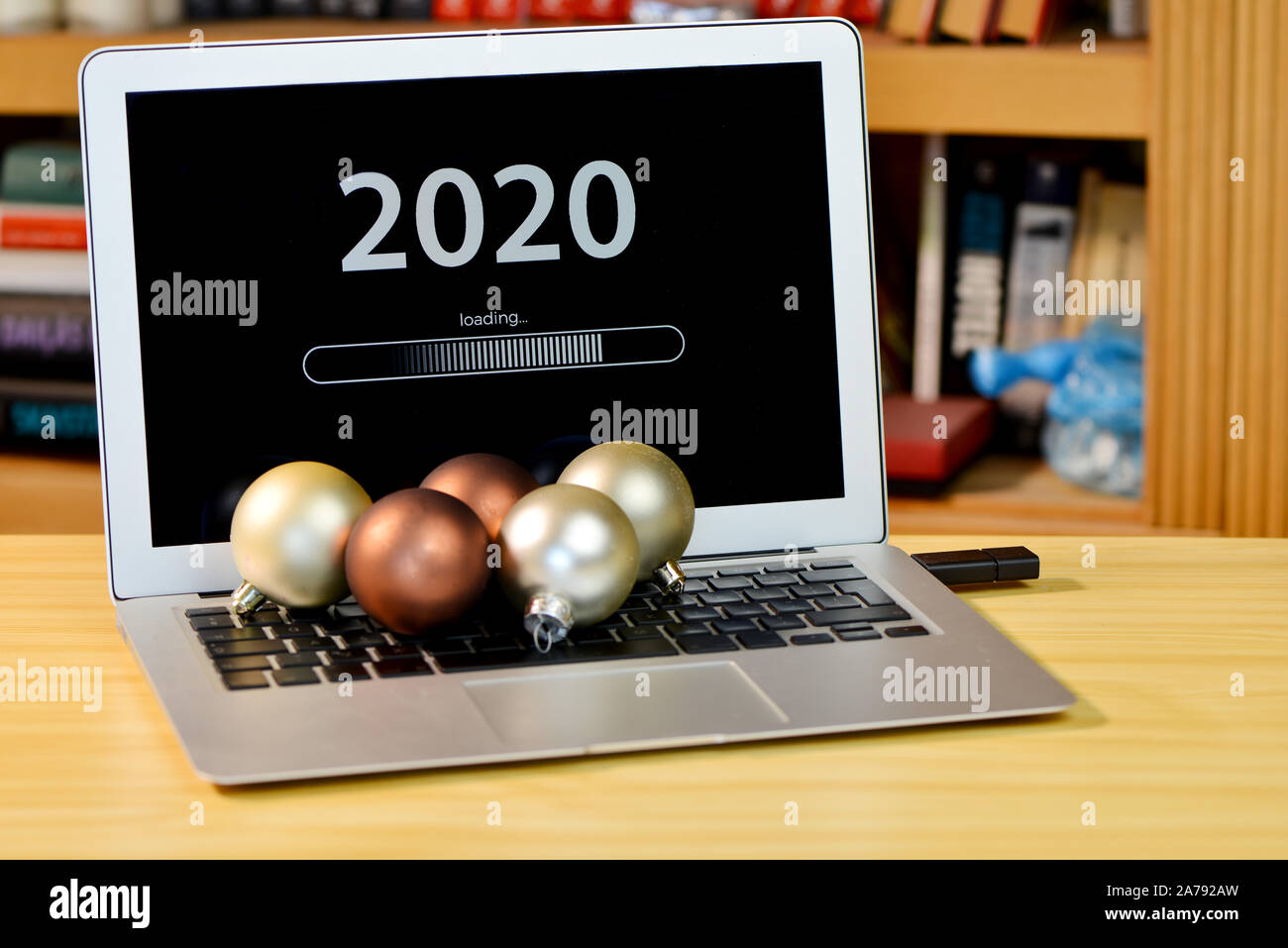Christmas 2020 Laptops on the table laptop with text   2020 loading   on screen and with