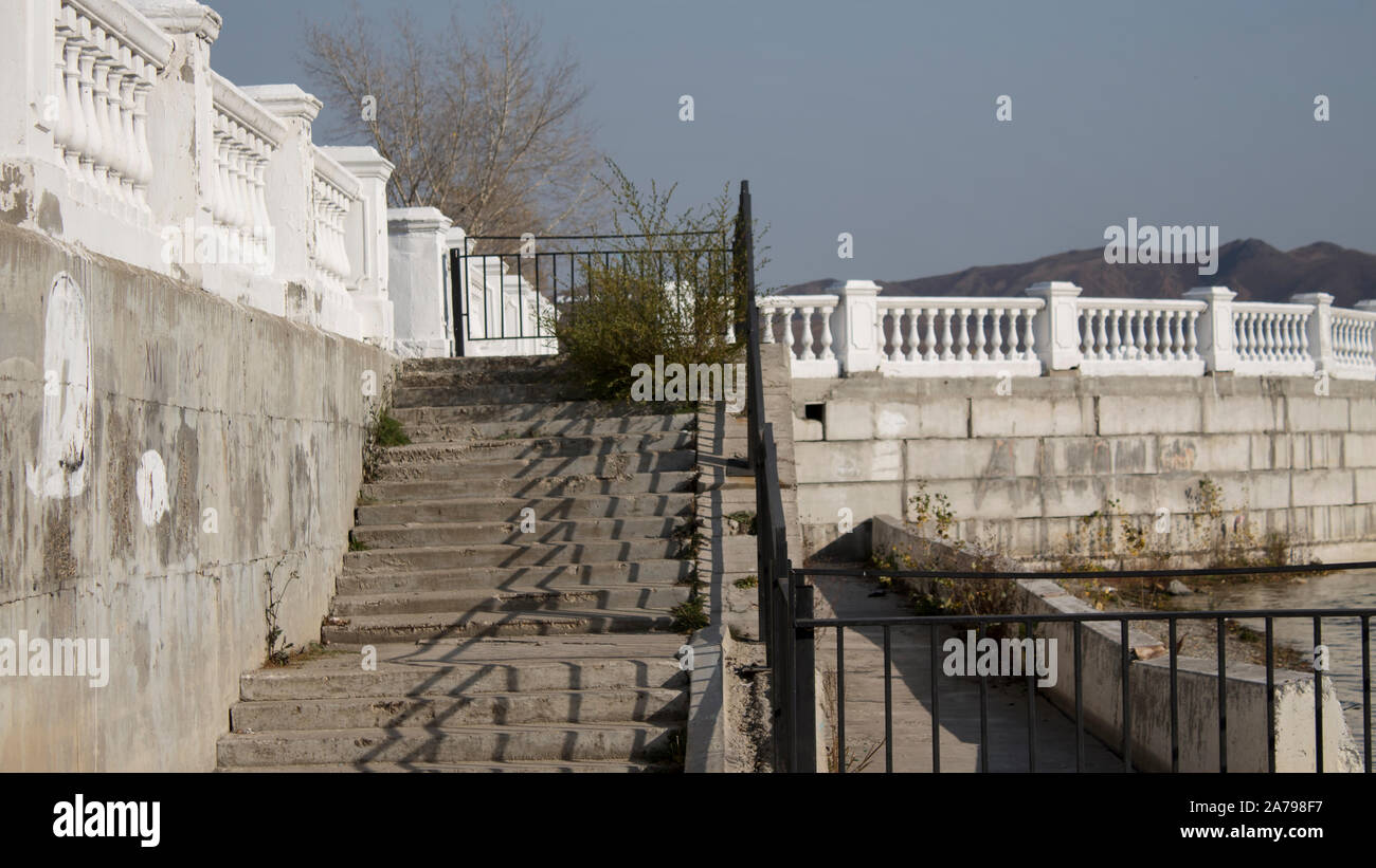White parapet. Antique style. Beautiful waterfront. Stock Photo
