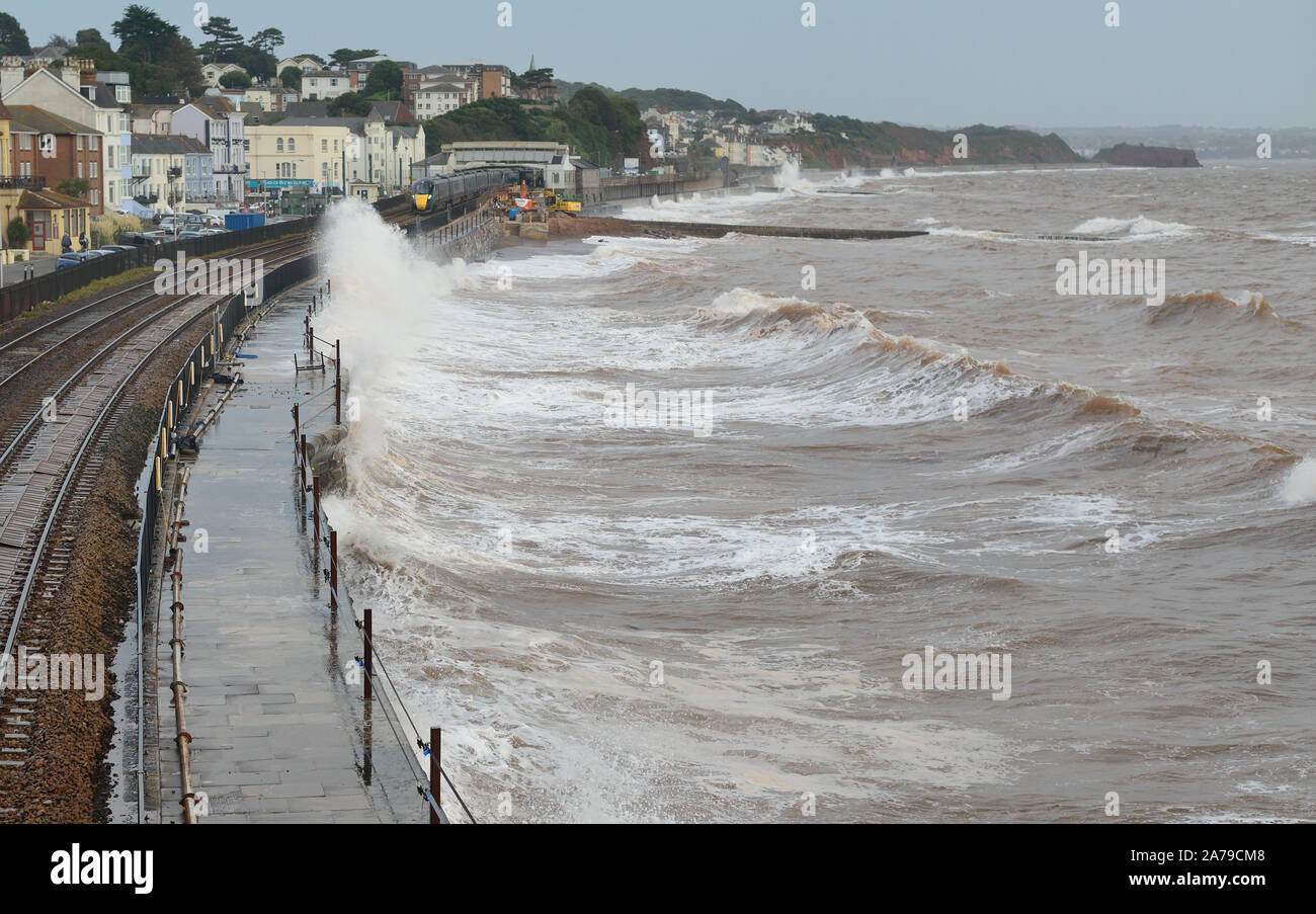 A westbound Intercity Express Train passing through Dawlish during high tide and rough sea. Stock Photo