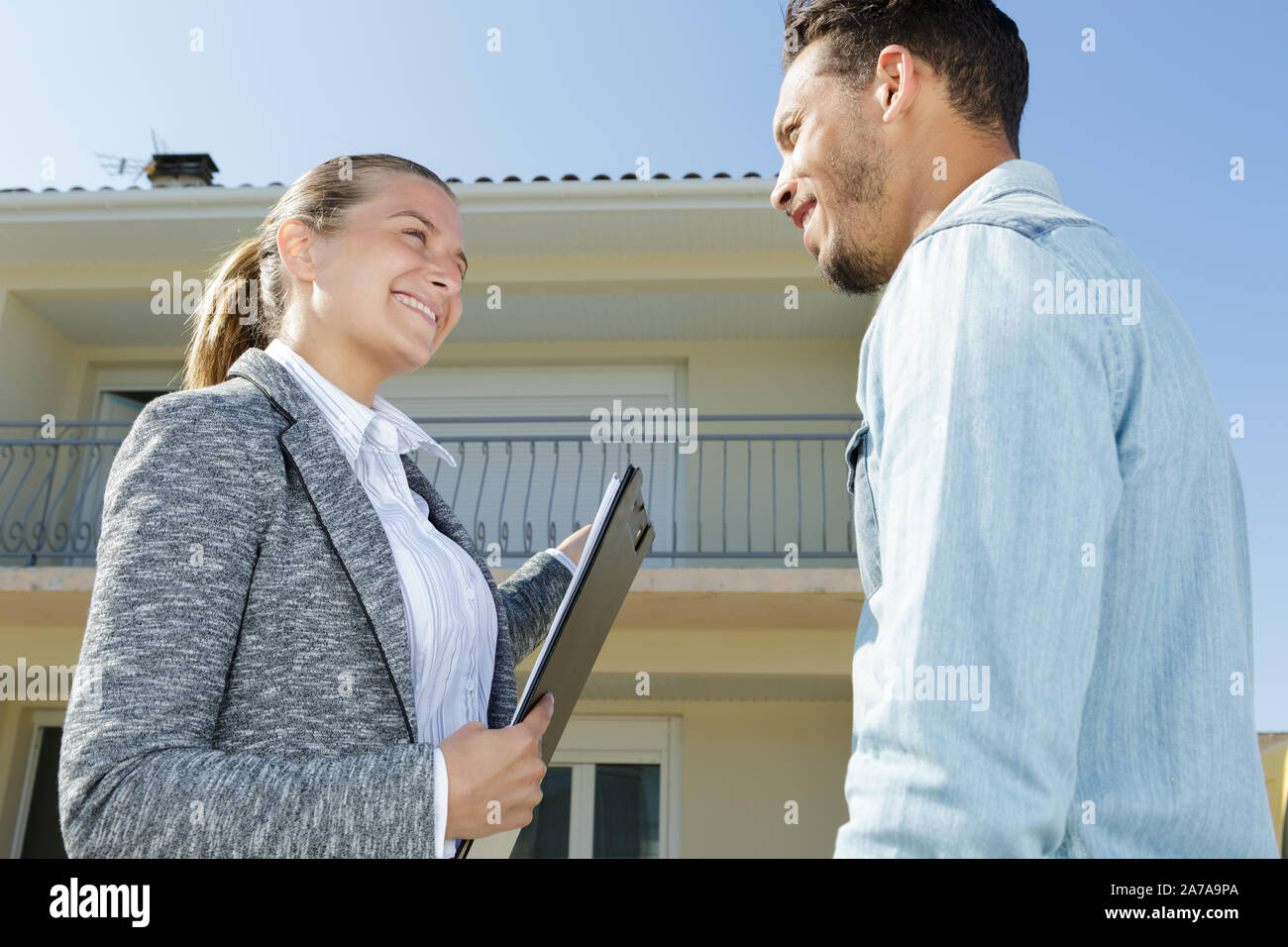 real estate agent shows new apartment in building Stock Photo