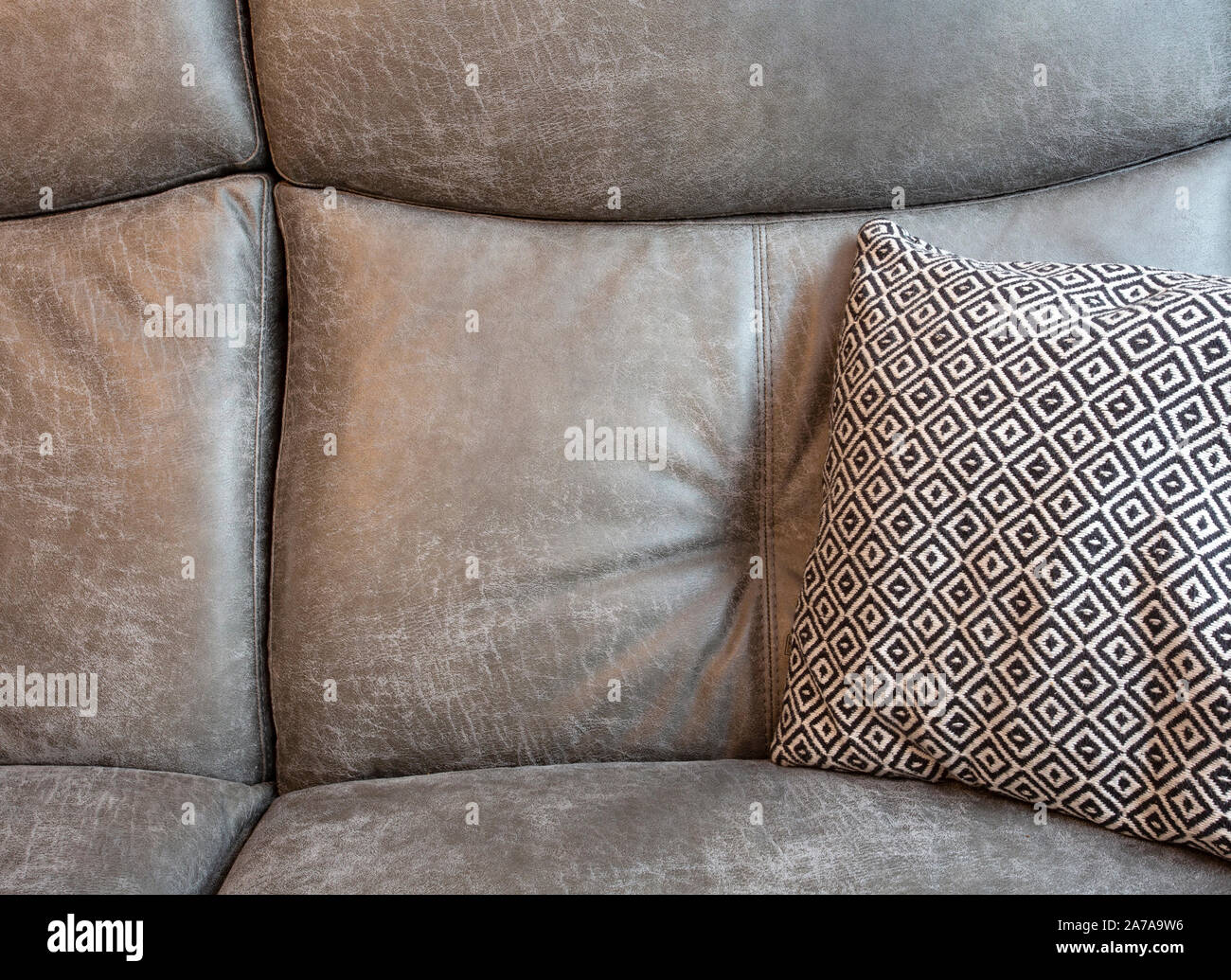Abstract Of Grey Leather Sofa And Black And White Pillows In