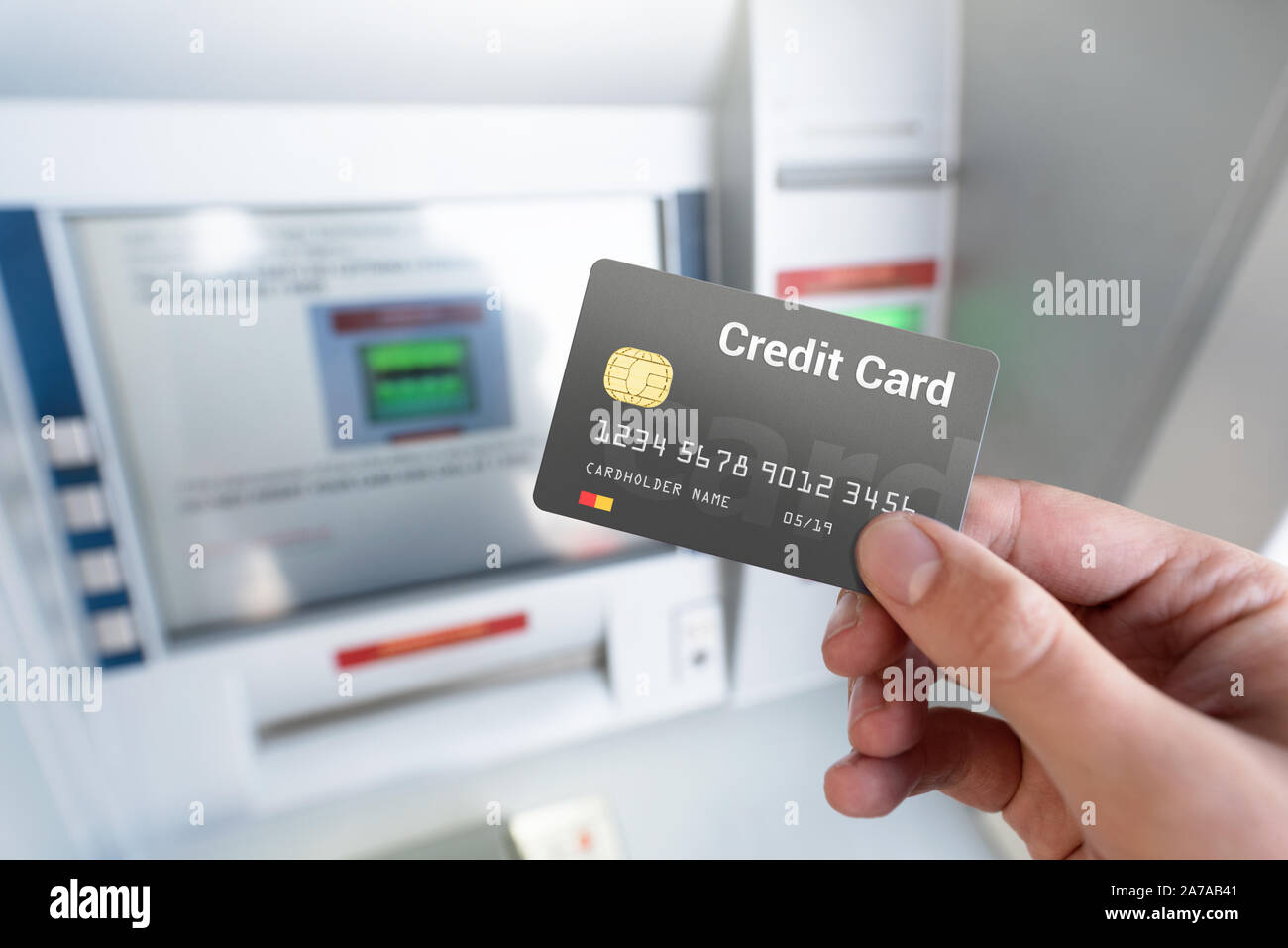 Withdraw money from an ATM using a credit card. Credit card close
