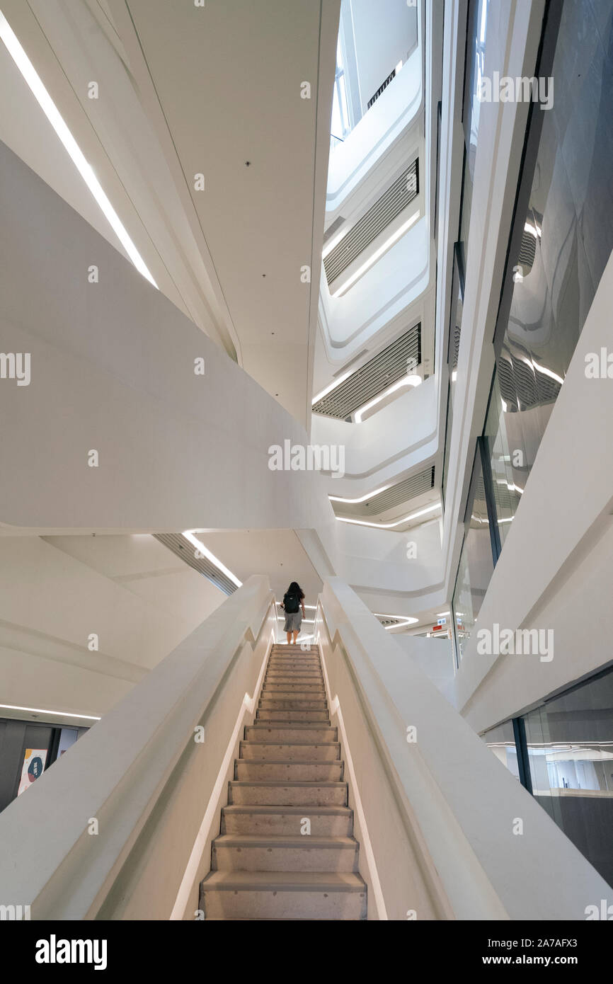 Interior of modern architecture of PolyU School of Design Jockey Club Innovation Tower at Hong Kong Polytechnic University, Hong Kong. Architect Zaha Stock Photo