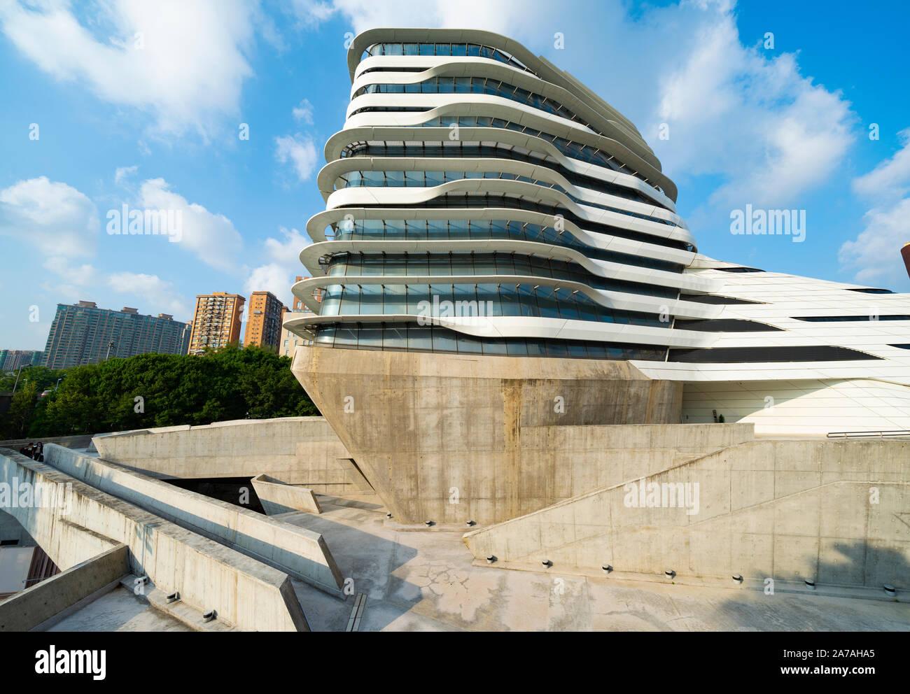 modern architecture of PolyU School of Design Jockey Club Innovation Tower at Hong Kong Polytechnic University, Hong Kong. Architect Zaha Hadid Stock Photo