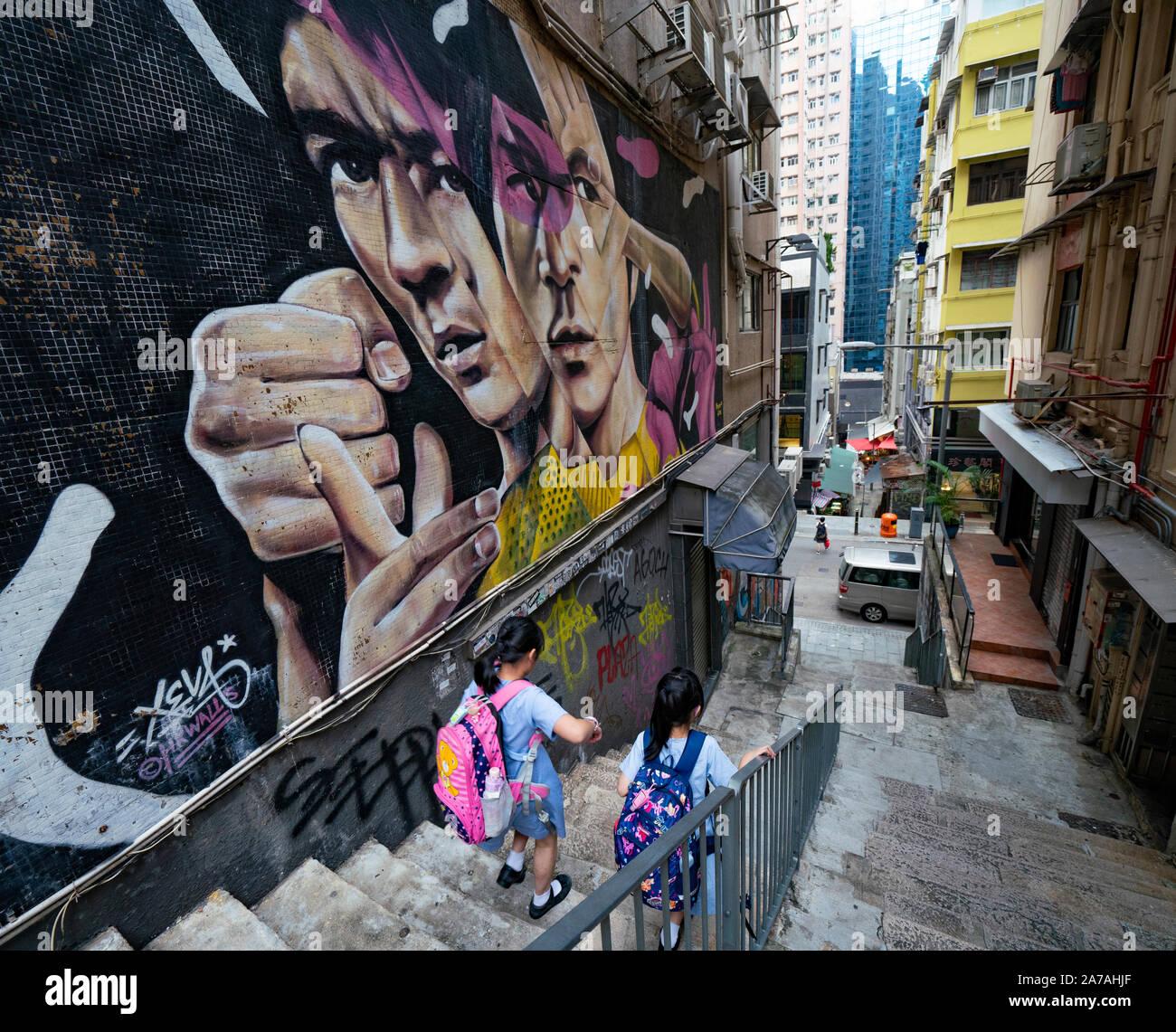 Street art of Bruce Lee by Xeva on  wall at Tank Lane in Sheung Wan Hong Kong, China Stock Photo