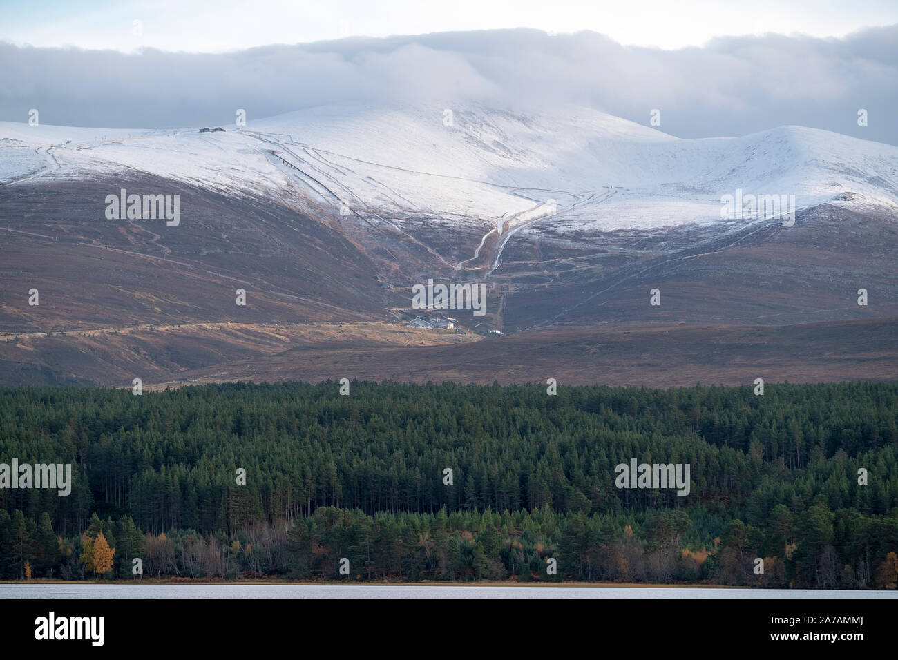 A view from Loch Morlich of the Cairngorm Mountain Ski Centre near Aviemore, Badenoch and Strathspey, Scotland Stock Photo