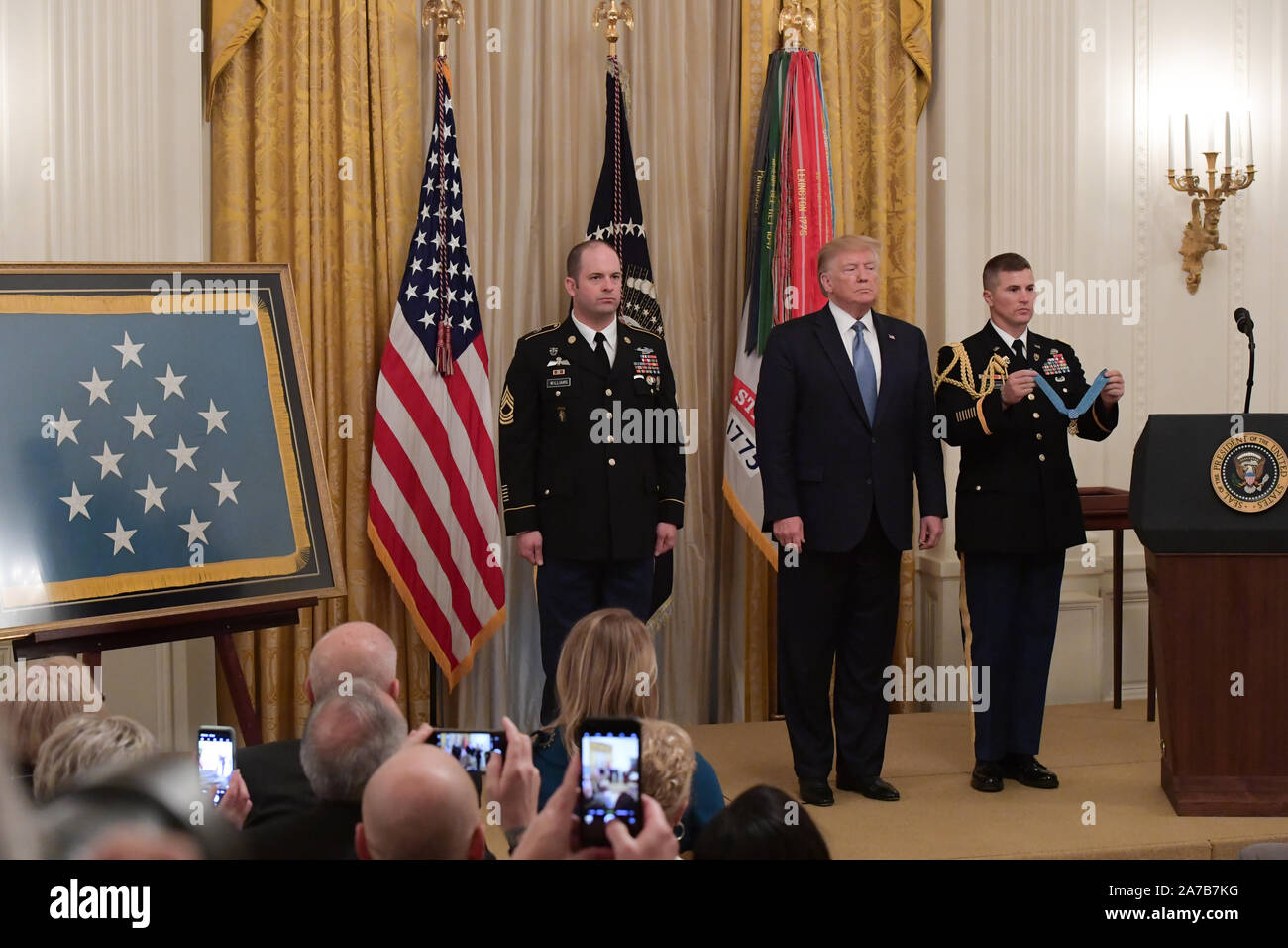 U.S. Army Master Sgt. Matthew O. Williams stands as the citation is read before receiving the Medal of Honor from President Donald J. Trump during a ceremony at the White House in Washington, D.C., Oct. 30, 2019. Williams was awarded the Medal of Honor for his actions while serving as a weapons sergeant with the Special Forces Operational Detachment Alpha 3336, Special Operations Task Force-33, in support of Operation Enduring Freedom in Afghanistan on April 6, 2008. (U.S. Army Photo by Sgt. Keisha Brown) Stock Photo