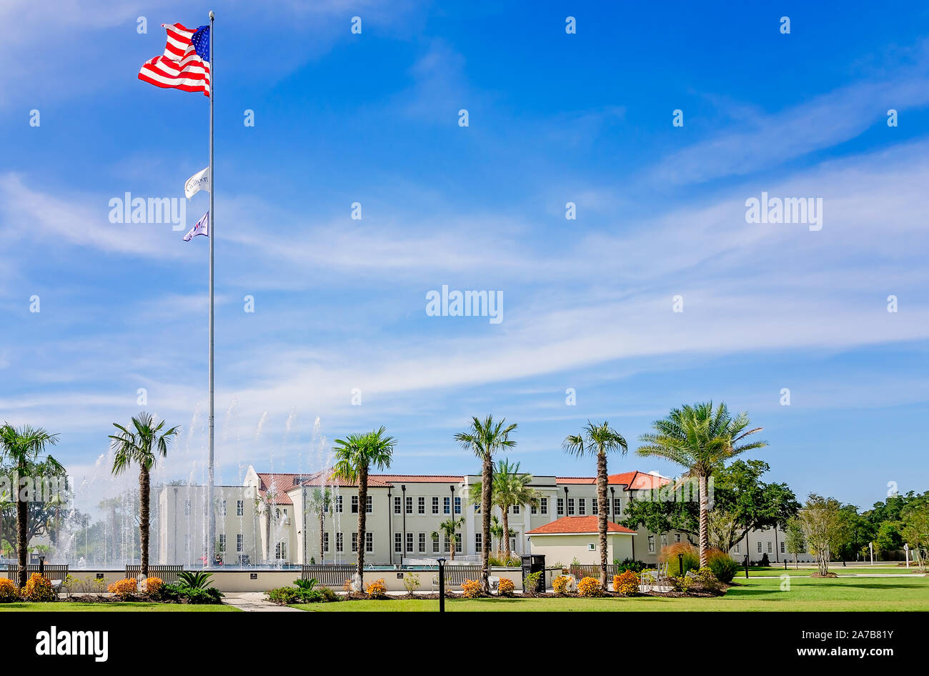 An American flag flies at the Centennial Plaza fountain, Oct. 22, 2019, in Gulfport, Mississippi. Stock Photo