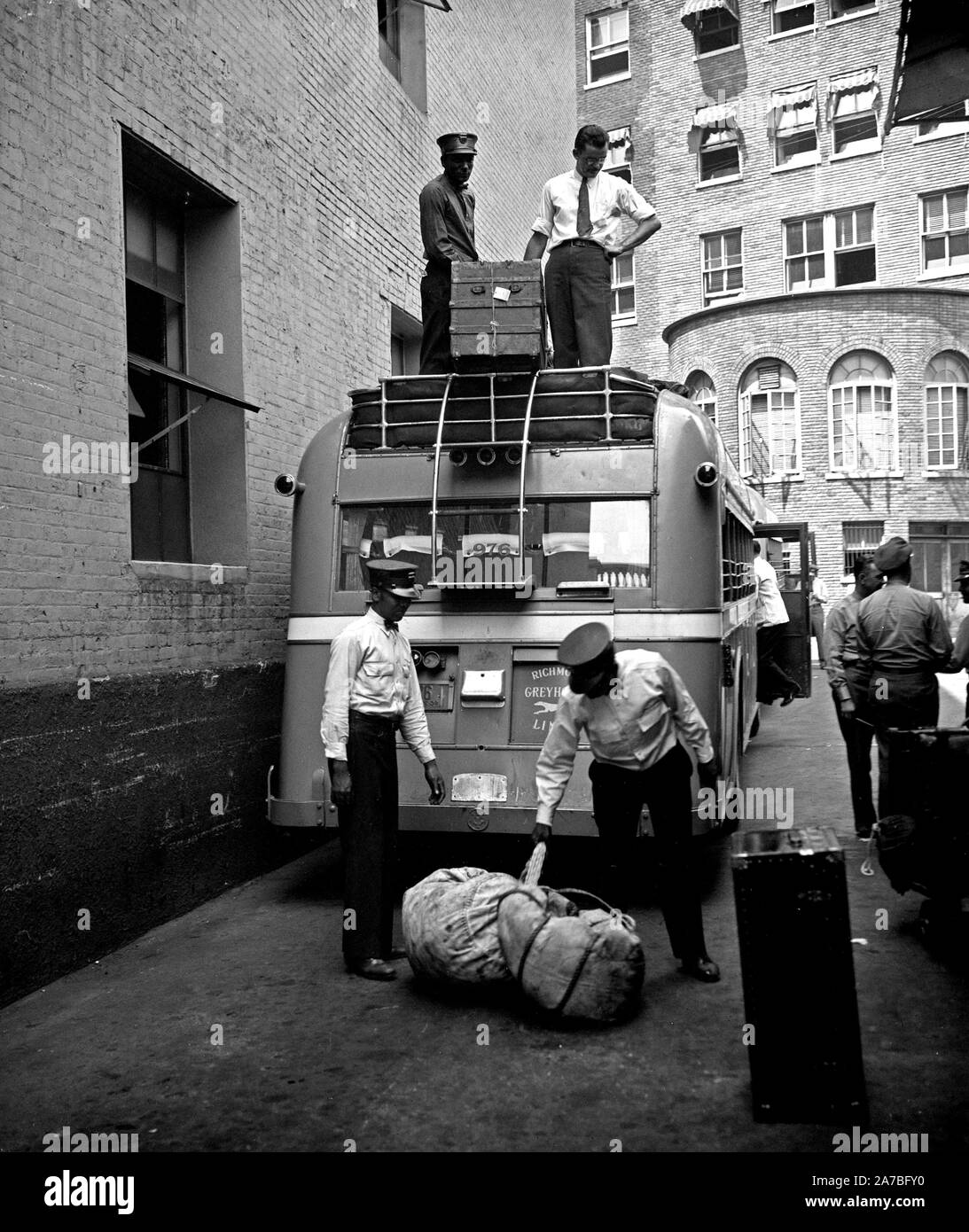 Workers At Greyhound Bus Station Loading Luggage Ca 1937 Stock Photo Alamy