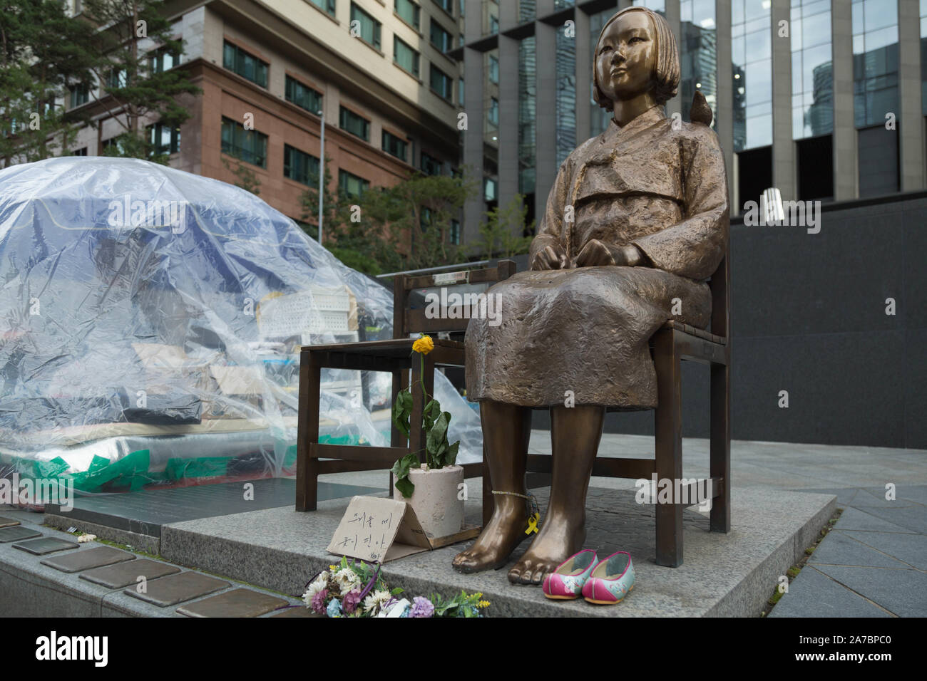 Seoul, South Korea. The Statue of Peace, also called Comfort Woman statue sits facing Japanese Embassy along with make shift camp site by activists. Stock Photo