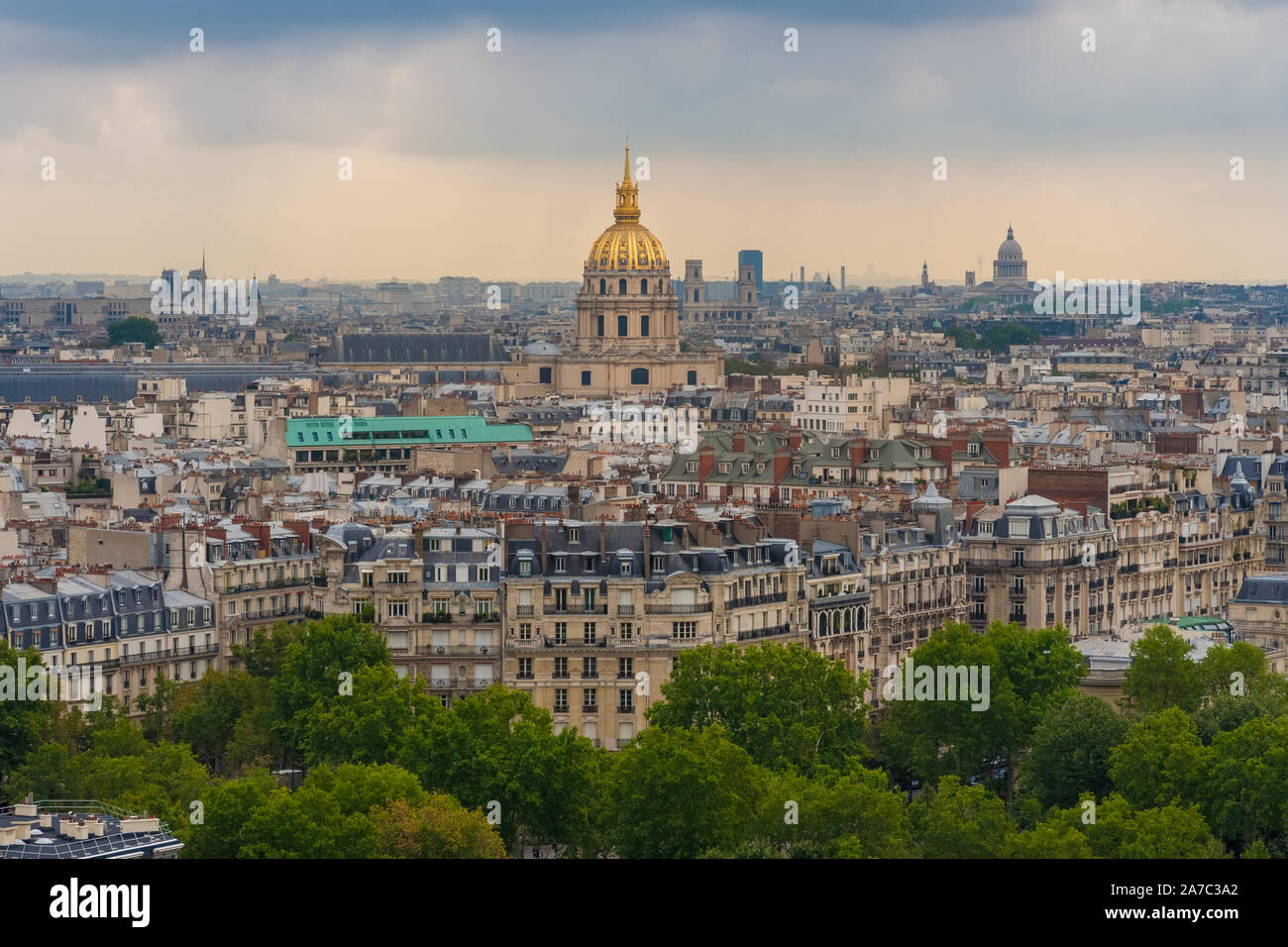 Beautiful aerial cityscape view of Paris with the golden dome of the Les Invalides complex surrounded by the typical Parisian residential buildings on... Stock Photo