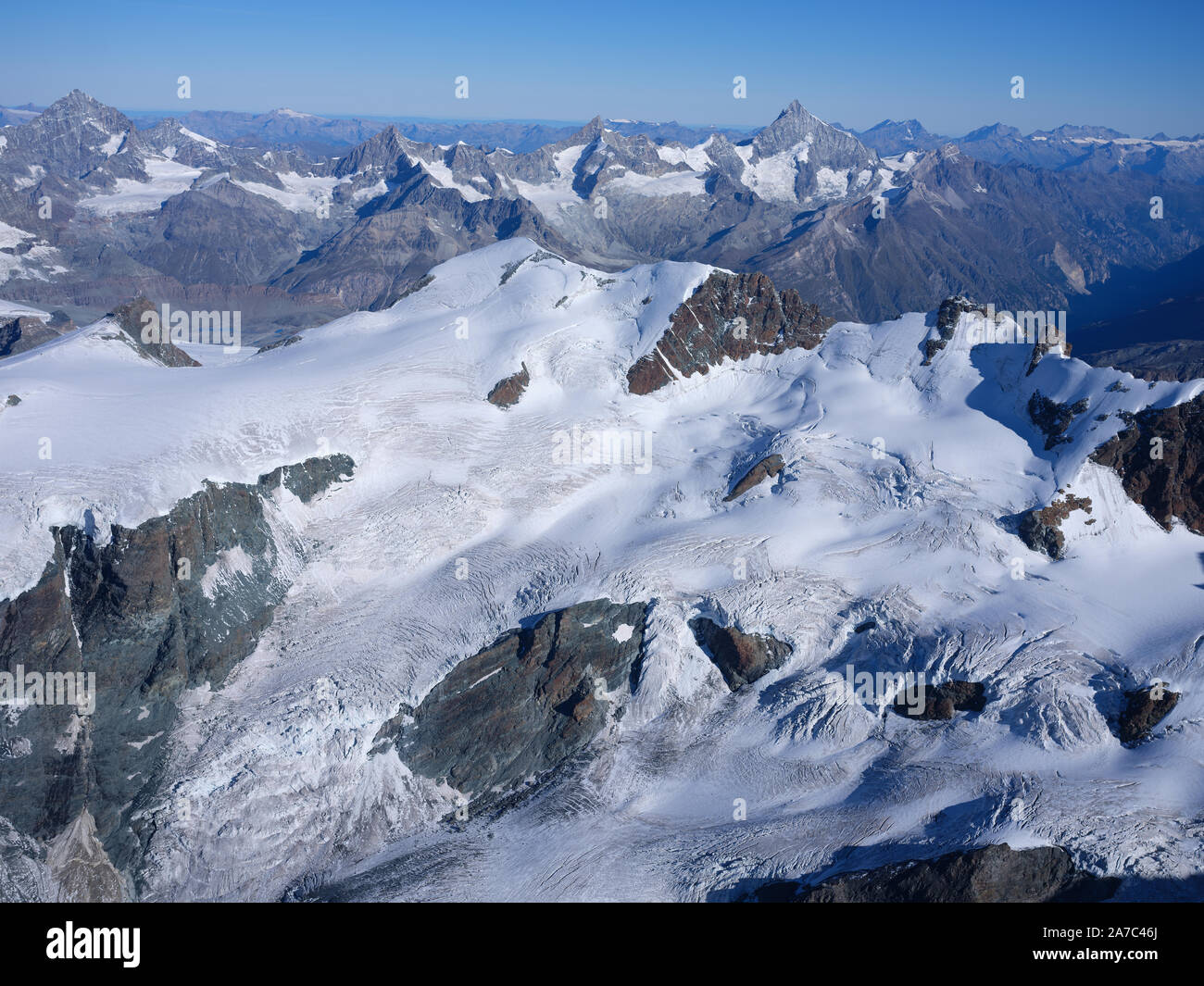 ITALIAN SIDE OF 4164m-HIGH BREITHORN, 4506m-HIGH WEISSHORN IN THE DISTANCE (aerial view). Aosta Valley, Italy & Canton of Valais, Switzerland. Stock Photo