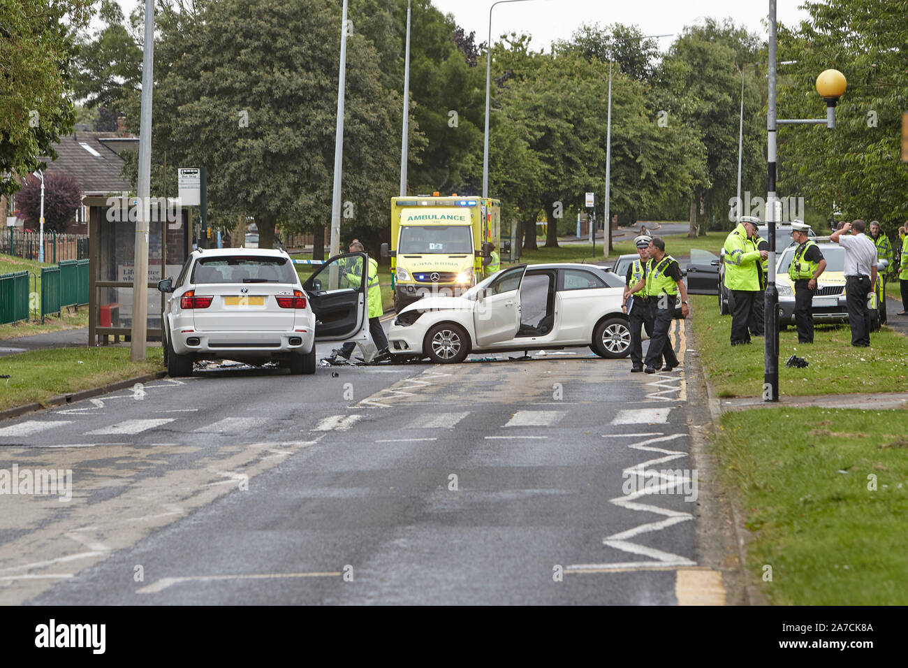 28th July 2016 - Emergency services attend a serious road traffic accident, RTA, following an head on car crash in West Hul, East Yorkshire, UK. Stock Photo