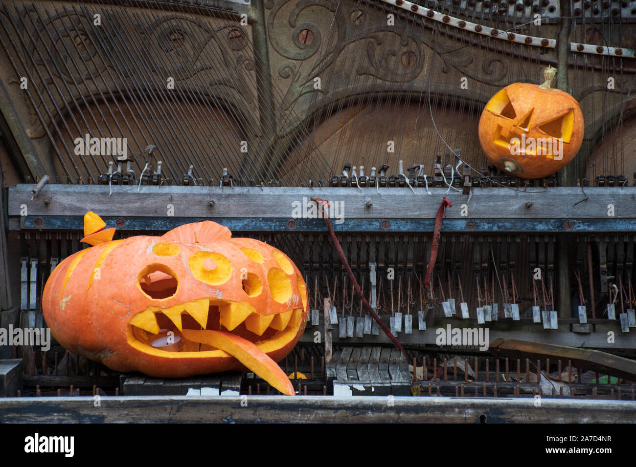 Spooky Funny Halloween Pumpkins Jack O Lantern On An Old Grand Piano Stock Photo Alamy