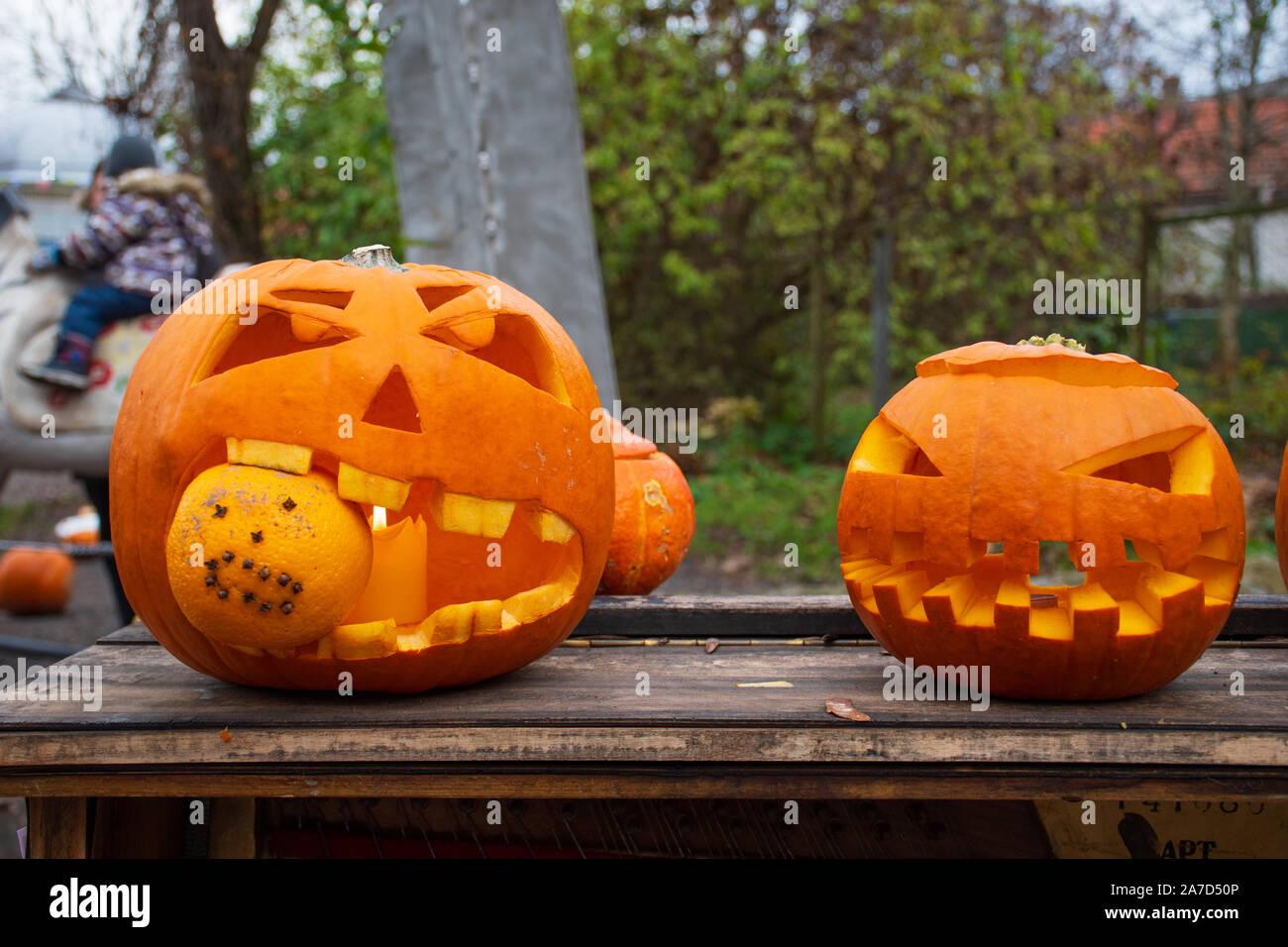 Spooky Funny Halloween Pumpkins Jack O Lantern With Burning Candle Stock Photo Alamy
