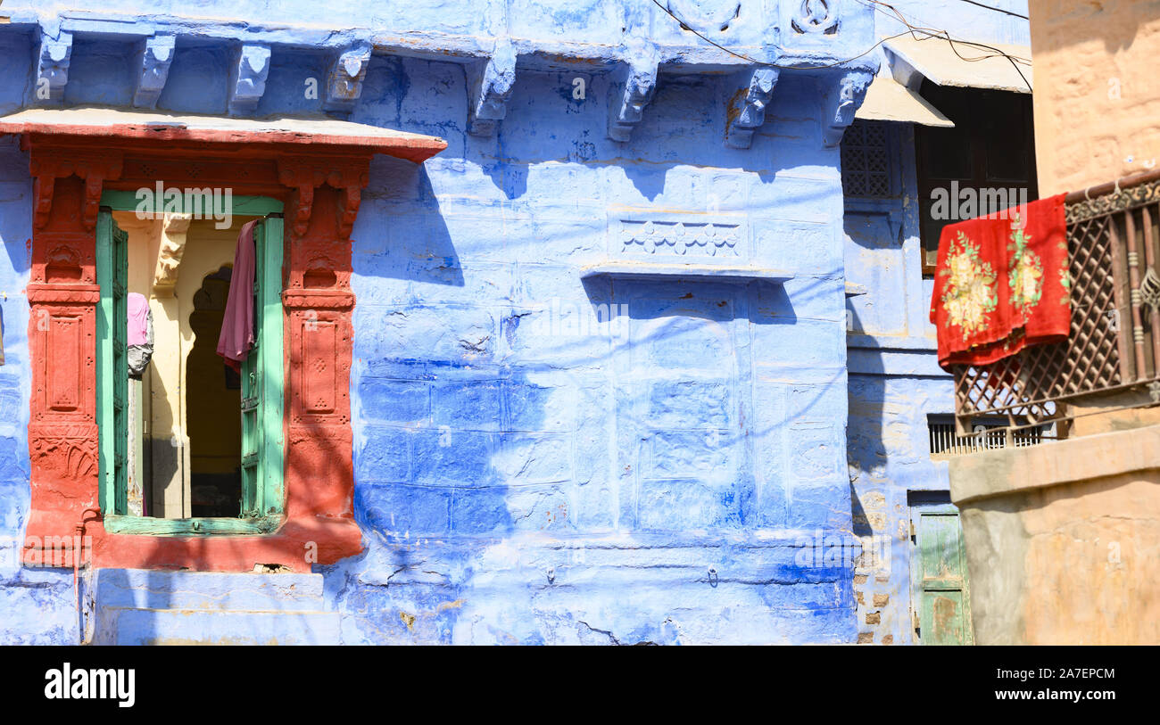 Stunning view of a colorful window of a house among the narrow streets of the blue city of Jodhpur, Rajasthan. Stock Photo