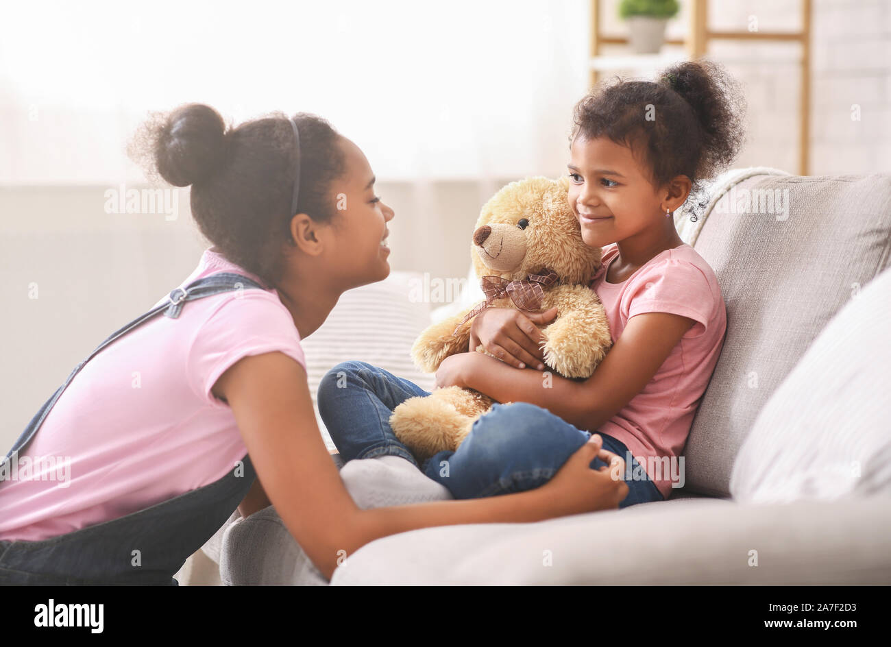 Swell Black Teen Girl Playing With Her Little Sister At Home Stock Photo Natural Hairstyles Runnerswayorg