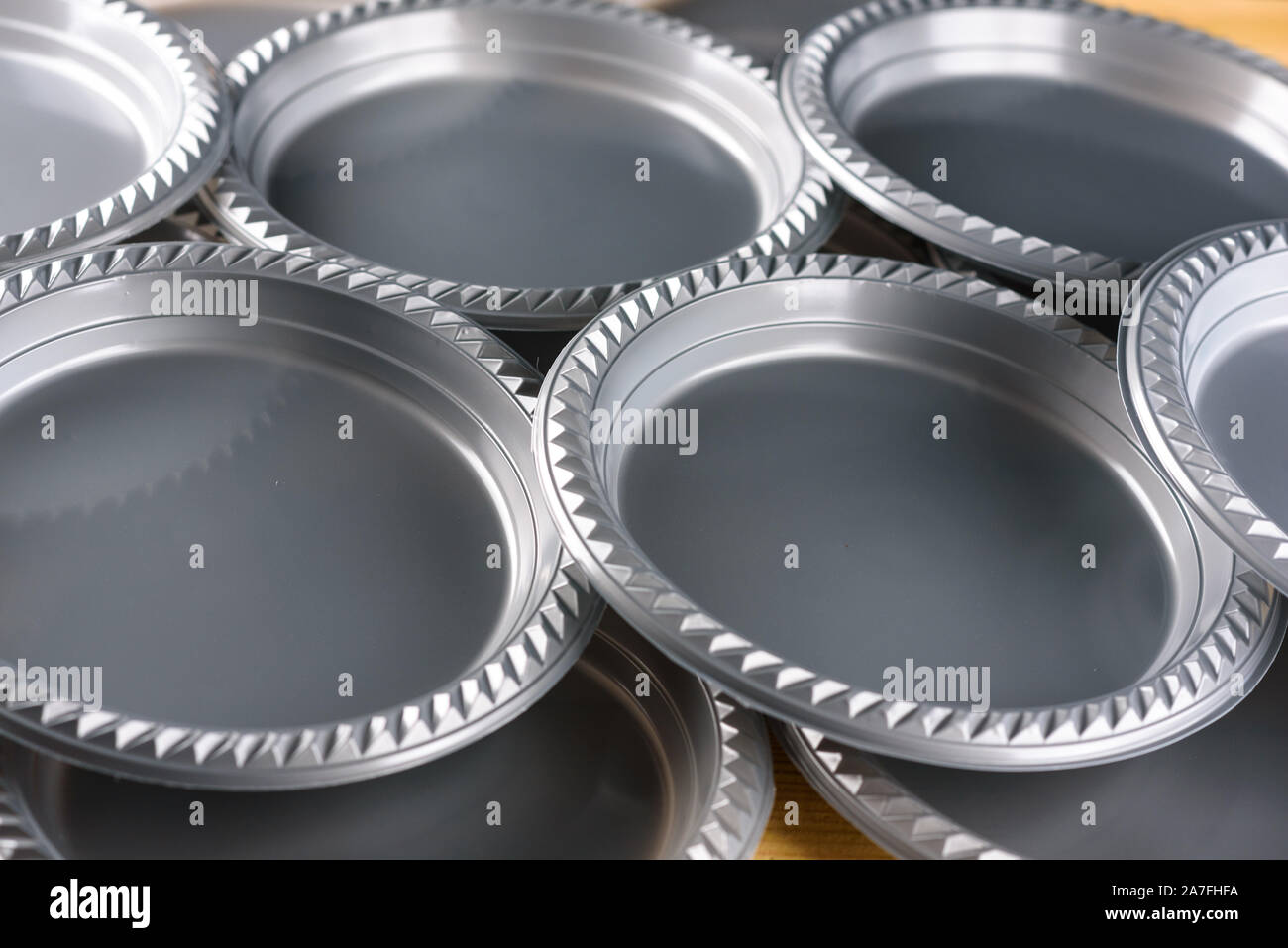 A group of disposable plastic dinner plates for wedding, party, birthday, catering. Stock Photo