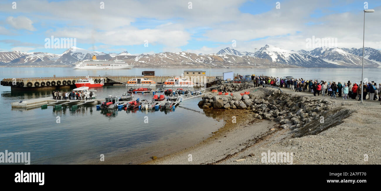 Passengers from P&O cruise ship Aurora queuing to return to their ship, seen anchored in the Kongsfjorden at Ny Alesund. Stock Photo