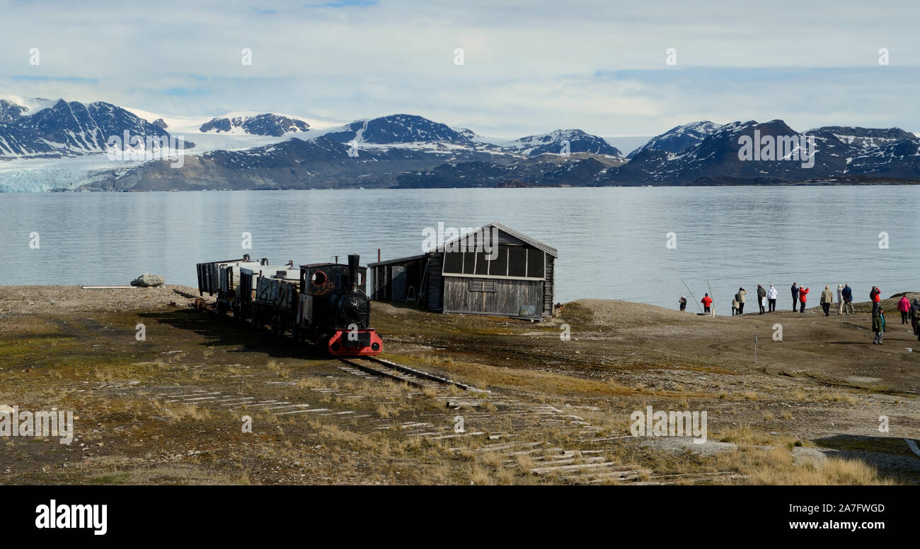 An old mining train on the shore of the Kongsfjorden at Ny Alesund on the island of Spitsbergen. Stock Photo