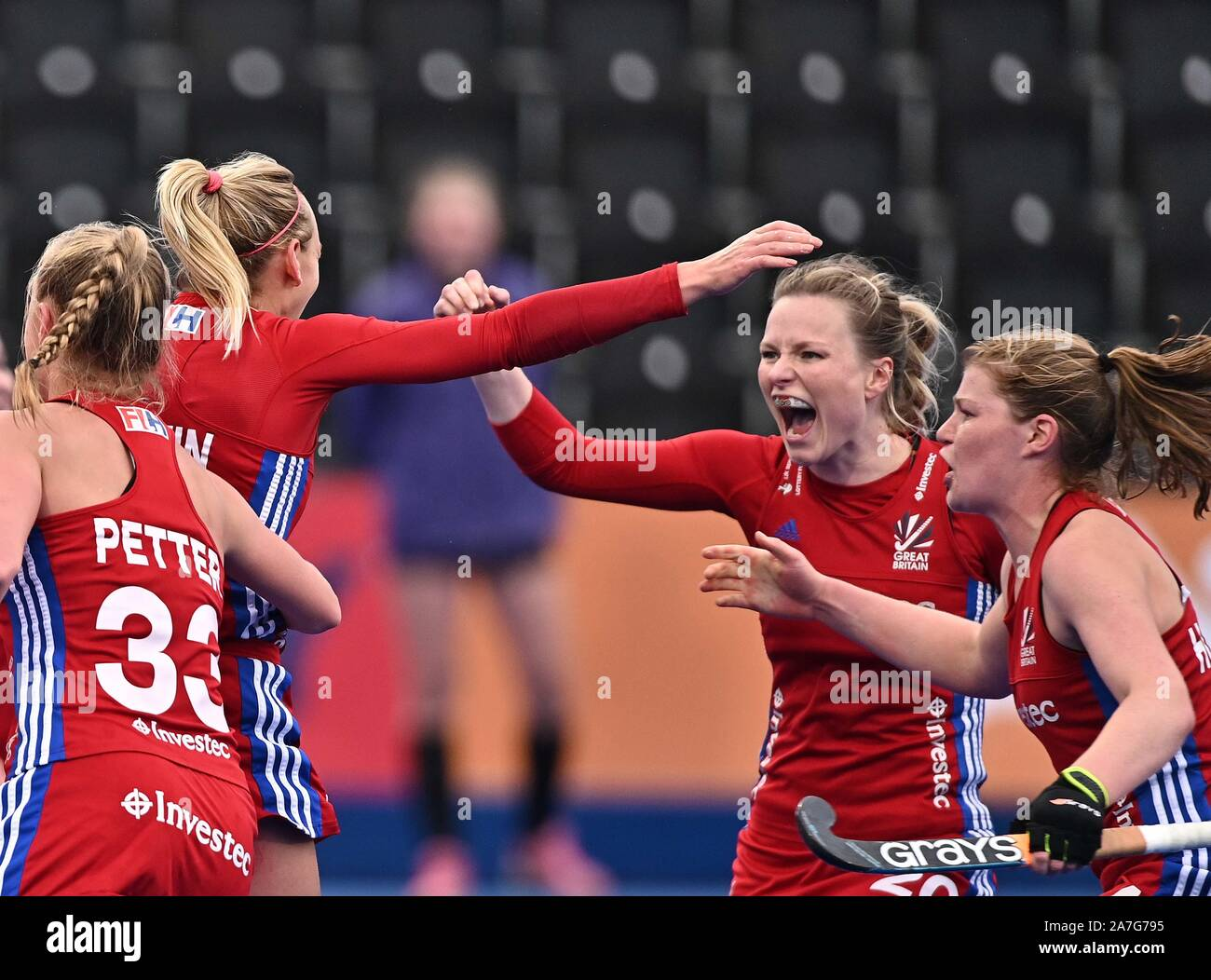 Stratford. United Kingdom. 02 November 2019. The Great Britain players celebrate their second goal. Izzy Petter (Great Britain, 33), Hollie Pearne-Webb (Great Britain, captain, 20) and Tess Howard (Great Britain). Great Britain v Chile. FIH Womens Olympic hockey qualifier. Lee Valley hockey and tennis centre. Stratford. London. United Kingdom. Credit Garry Bowden/Sport in Pictures. Credit: Sport In Pictures/Alamy Live News Stock Photo