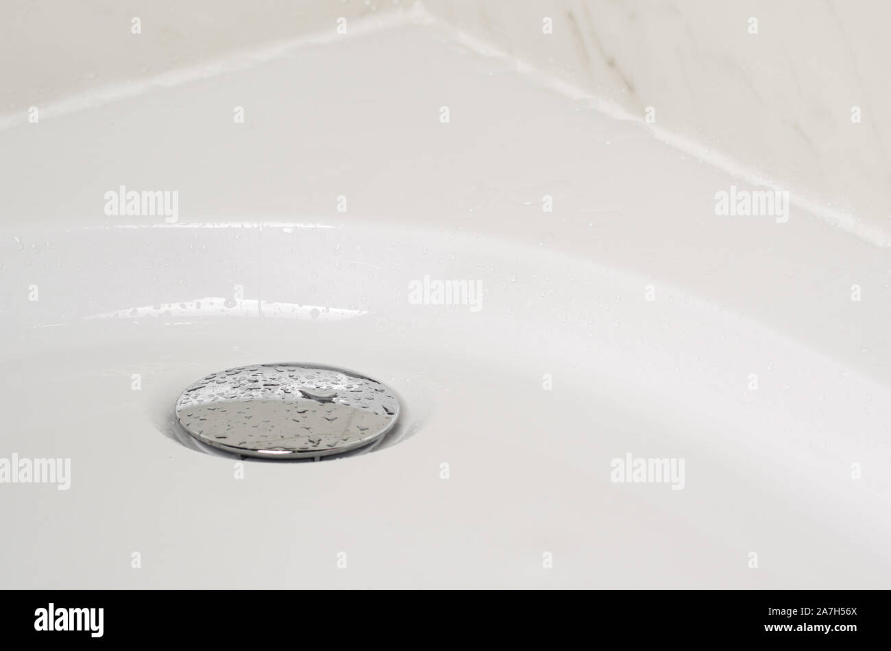 Shower tray and water tap or drain plug with drops of water. Fungus cleaning concept. Stock Photo