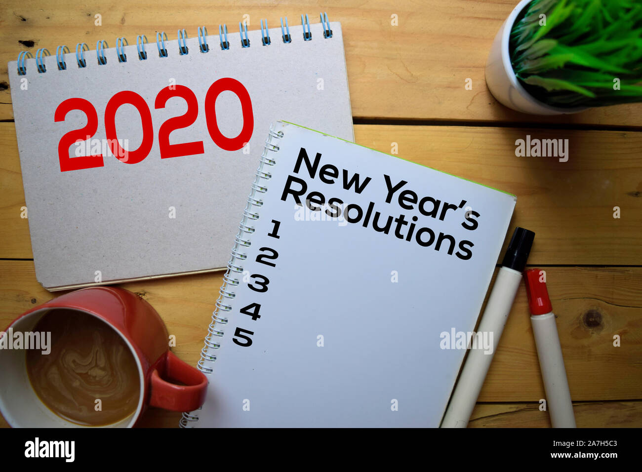 2020 New Year S Resolutions Write On The Book With Wooden Table Background Stock Photo Alamy