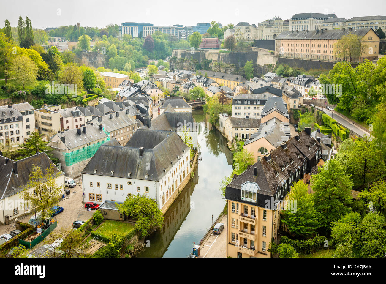 Alzette river bend with old houses along  reflected in water Luxembourg city, Luxembourg Stock Photo