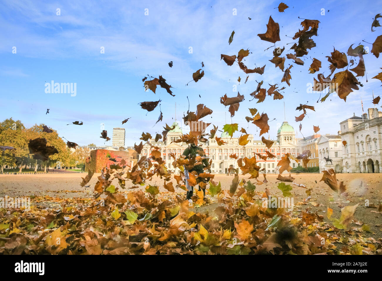 London, UK, 03rd Nov 2019. Westminster leaf blowing contractors are out on Horse Guards Parade in beautiful sunshine, clearing the large open space often used for parades of autumnal leaves and debris. Credit: Imageplotter/Alamy Live News Stock Photo