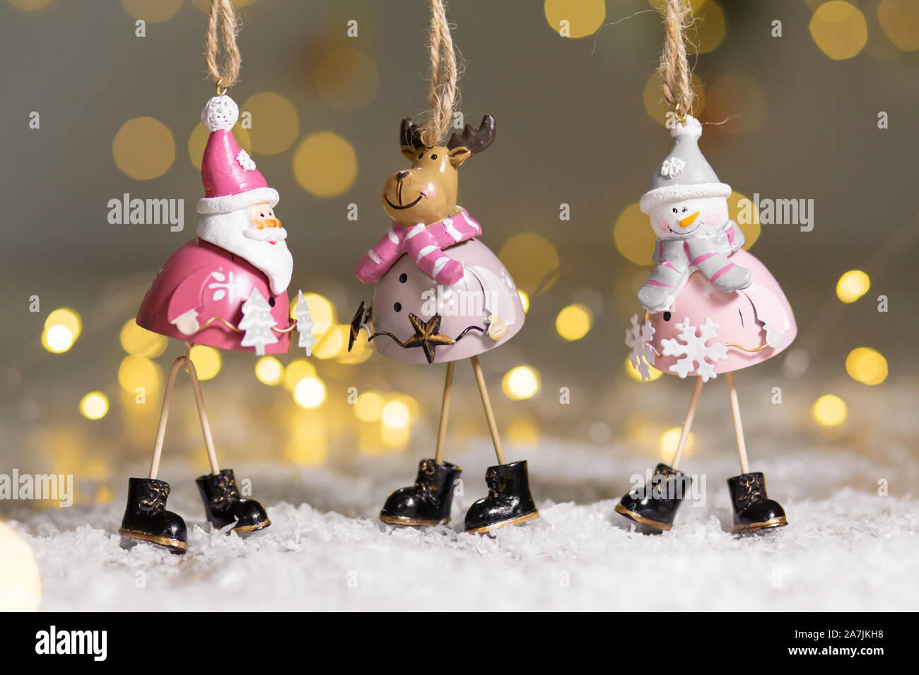 Decorative Figurines Of A Christmas Theme Set Of Statuettes Of Santa Snowman And Deer Christmas Tree Decoration Festive Decor Warm Bokeh Lights Stock Photo Alamy
