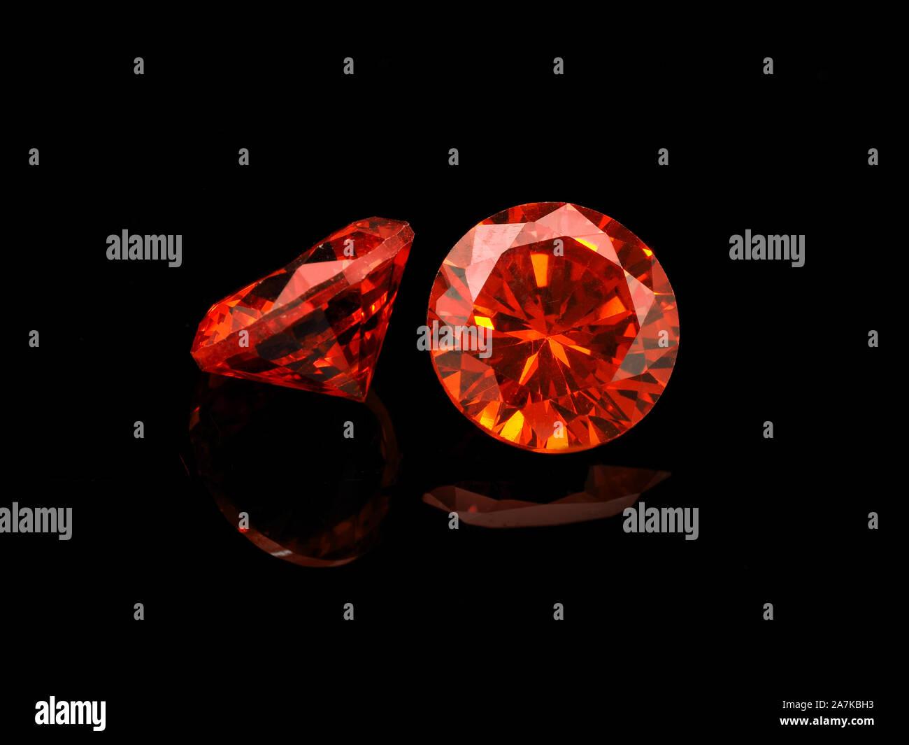 Light Red Semi-Precious Gemstone on a Black Background. Stock Photo