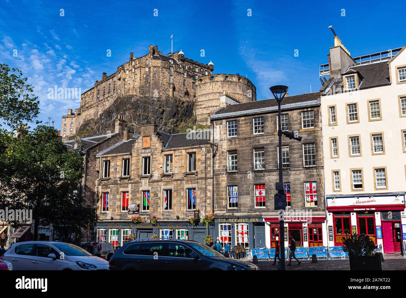 View of Edinburgh Castle Above Historic Buildings in the Grassmarket With Blue Sky. Edinburgh, Scotland. Stock Photo