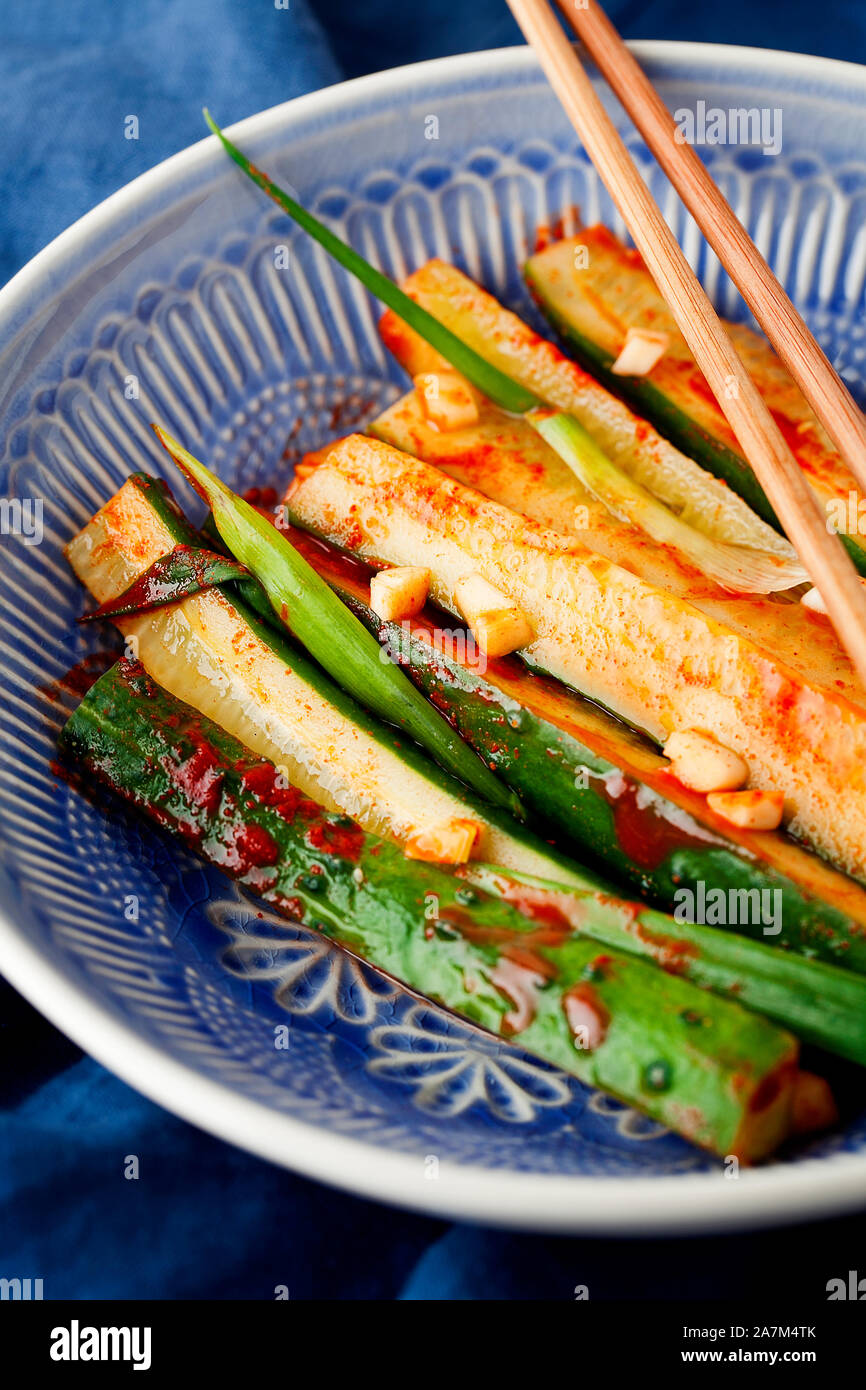 Korean Kimchi Pickle Cucumber Marinated Cucumbers With Chili Pepper Garlic Greens Onion In Blue Plate Close Up Healthy Vegan Snack With Probiotic Stock Photo Alamy