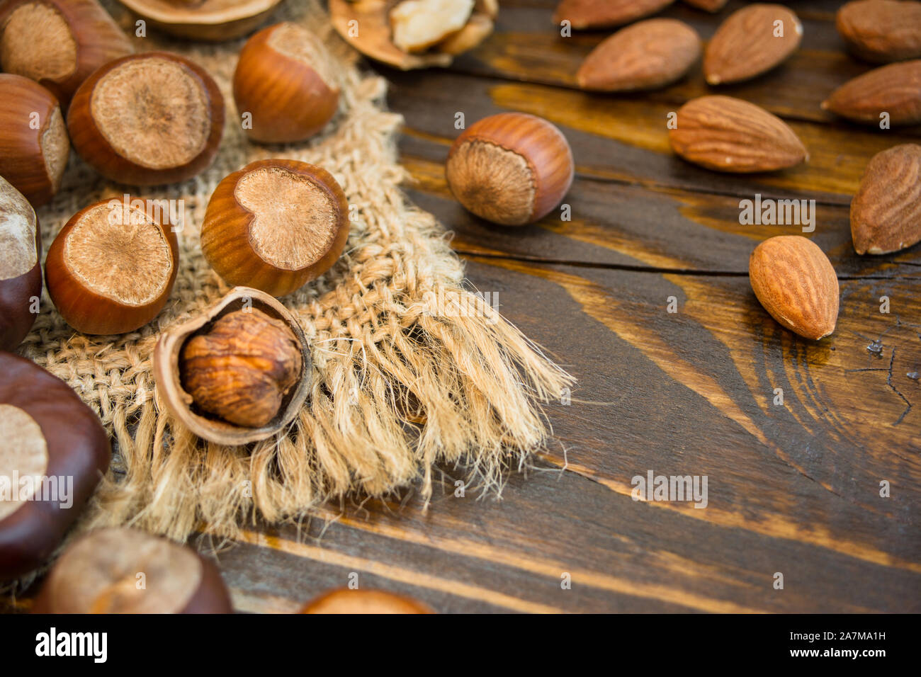 Mix of different nuts on a rustic background. Close-up photo with copy space. Healthy nutrition concept. Stock Photo