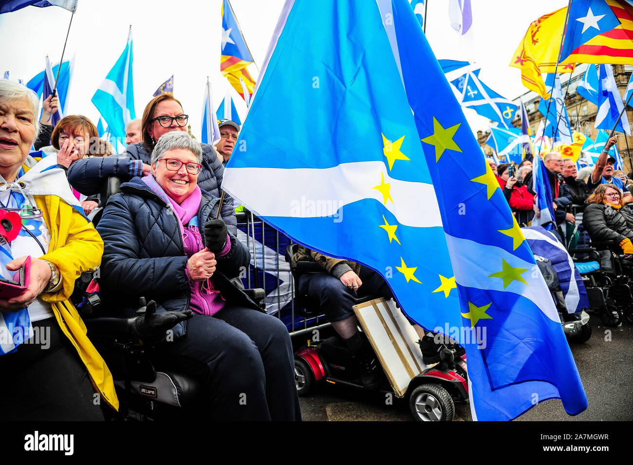 Glasgow, UK. 02nd Nov, 2019. An independence supporter holds her Scotland in Europe flag during the IndyRef2020 rally hosted by The National Newspaper. Credit: SOPA Images Limited/Alamy Live News Stock Photo