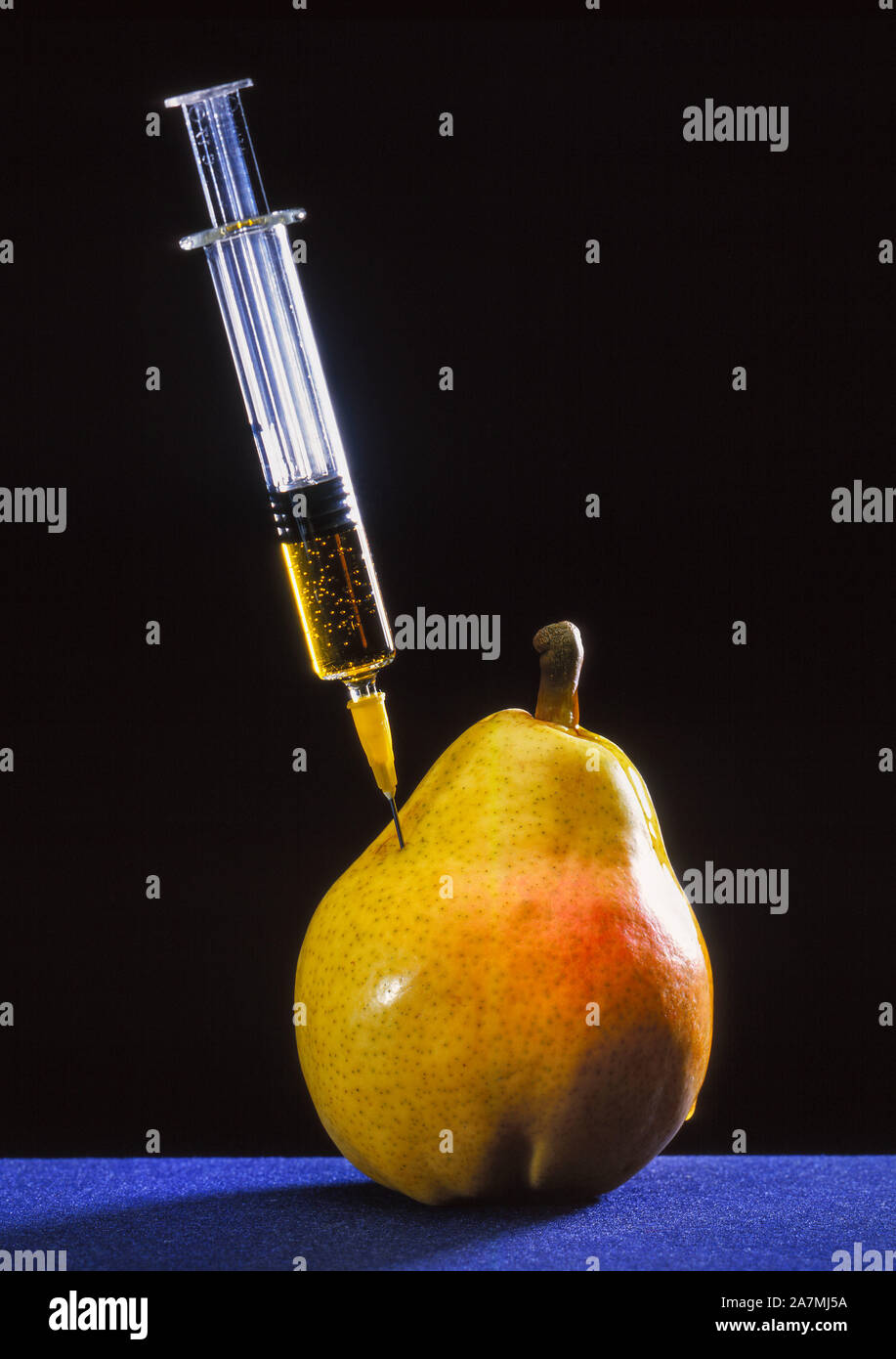 Gene manipulation, syringe in a pear Stock Photo