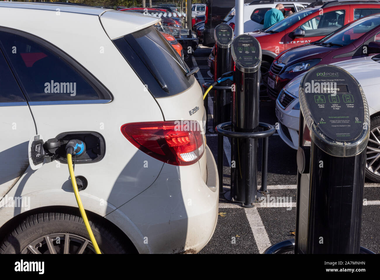 Electric car charging at PodPoint destination charger. Stock Photo
