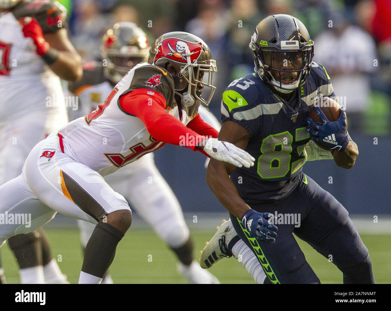 Seattle, United States. 03rd Nov, 2019. Seattle Seahawks wide receiver David Moore (83) picks up first down yardage against Tampa Bay Buccaneers cornerback Carlton Davis (33) second quarter at CenturyLink Field on Sunday, November 3, 2019 in Seattle, Washington. The Buccaneers lead the Seahawks 21-13 at halftime. Jim Bryant Photo/UPI Credit: UPI/Alamy Live News Stock Photo
